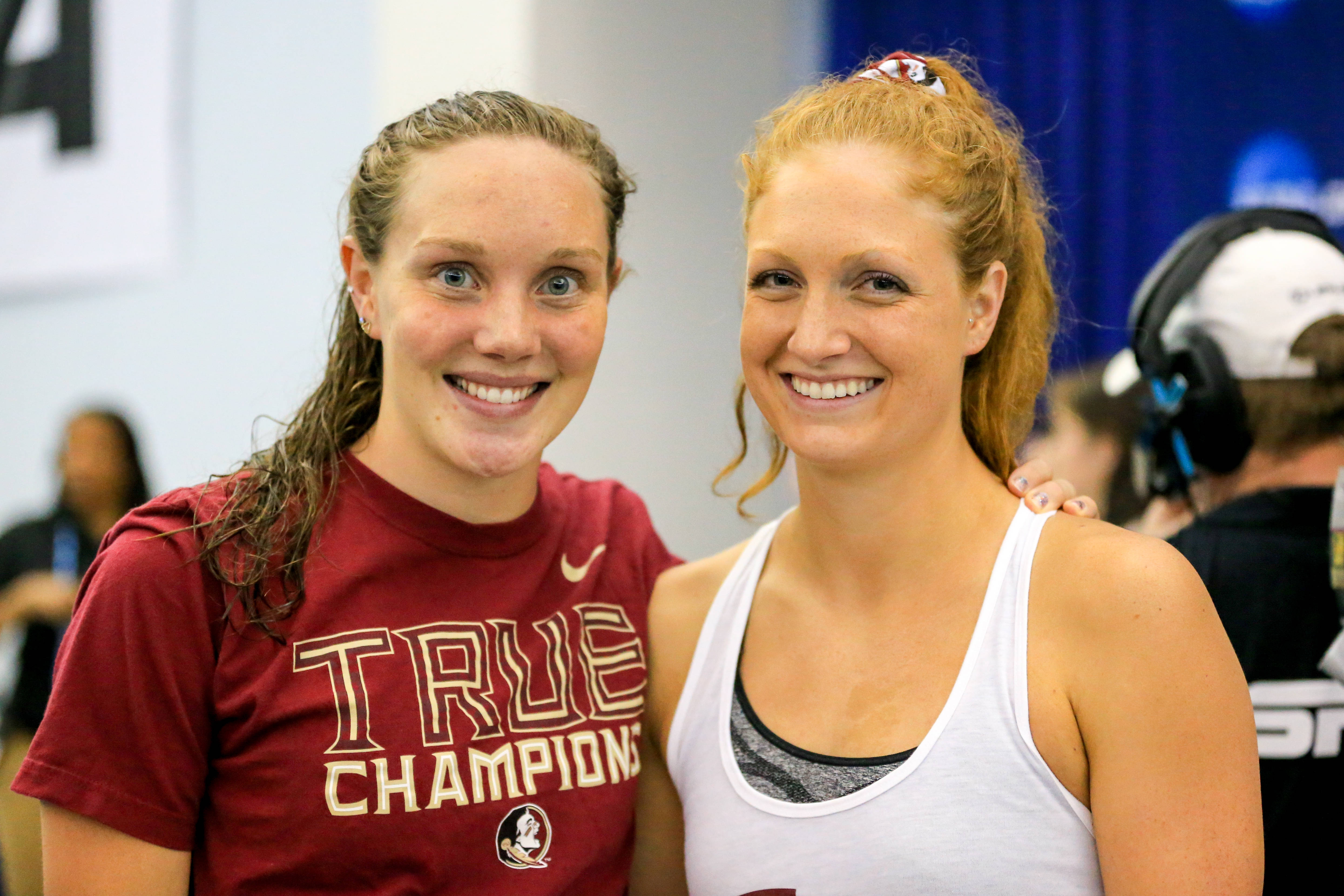 Kaitlyn Dressel and Haley Powell smile after the meet