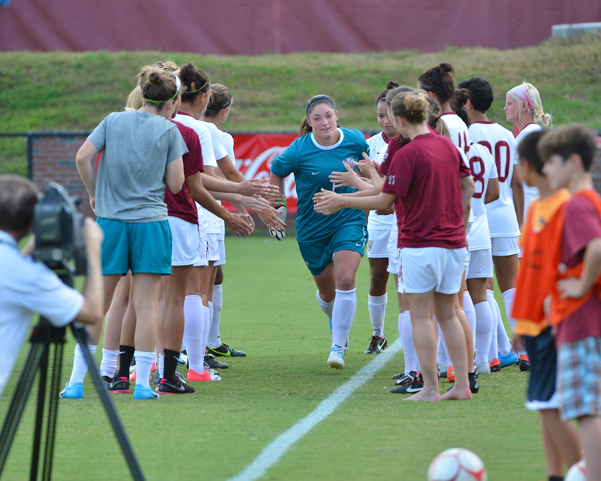 Taylor Vancil runs through the tunnel during pre-game starting line-ups.