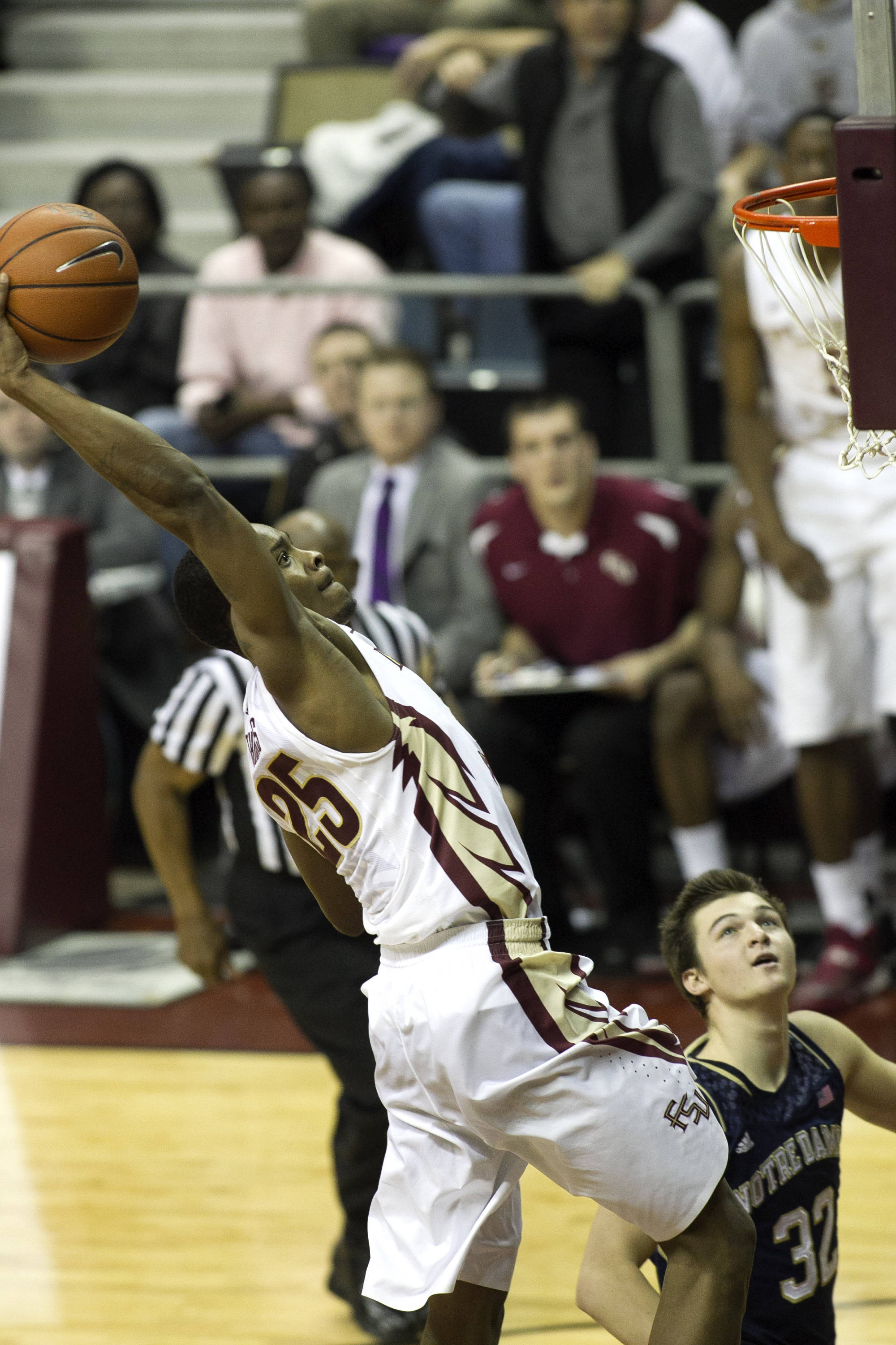 Aaron Thomas (25) with a big jam, FSU vs Notre Dame, 1-21-14, (Photo's by Steve Musco)