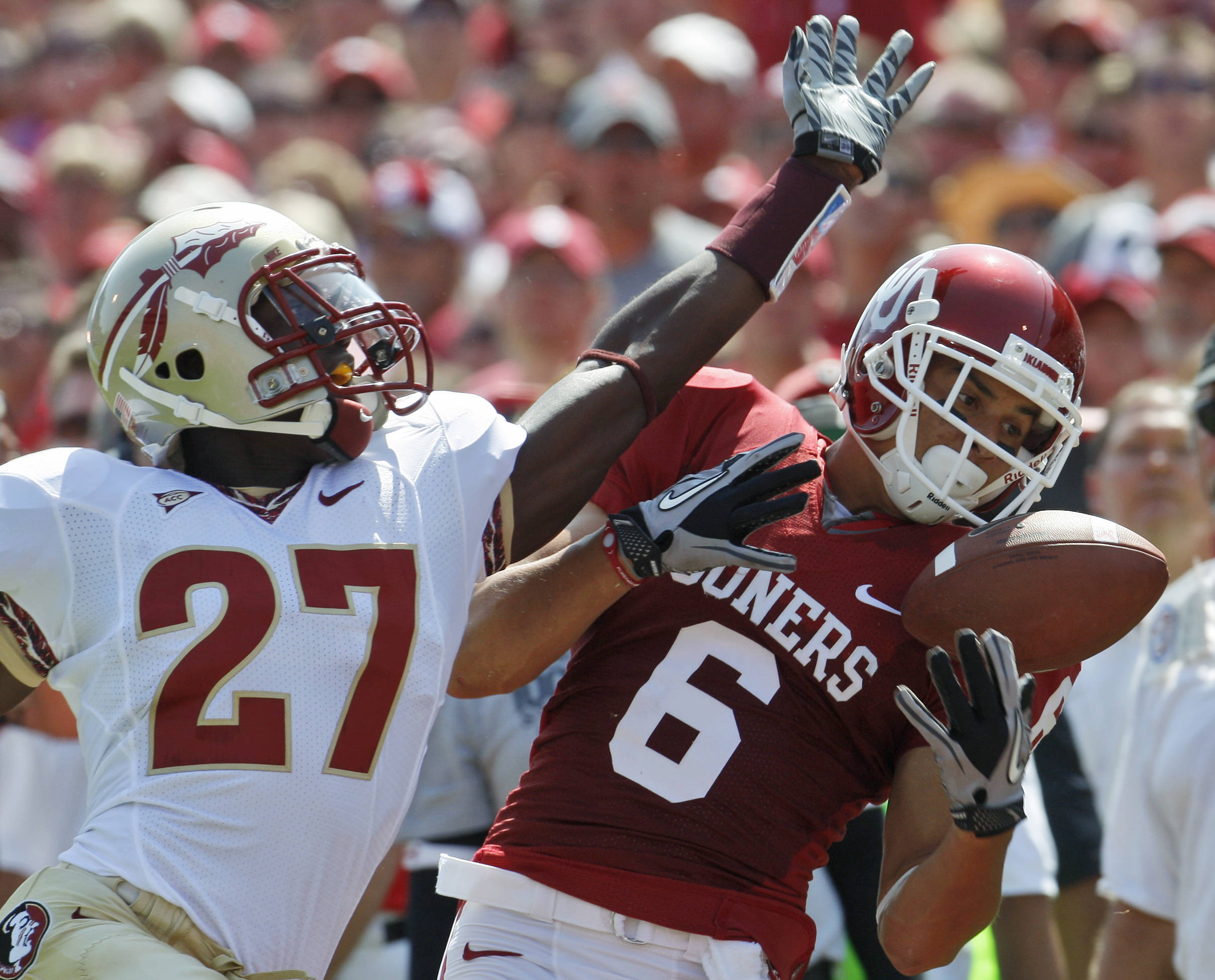 Florida State cornerback Xavier Rhodes, left, breaks up a pass intended for Oklahoma wide receiver Cameron Kenney in the first quarter of an NCAA college football game in Norman, Okla., Saturday, Sept. 11, 2010. (AP Photo/Sue Ogrocki)