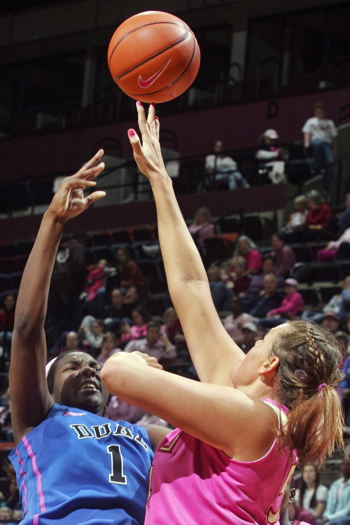 Florida State's Cierra Bravard (54) fouls Duke's Elizabeth Williams (1). (AP Photo/Phil Sears)