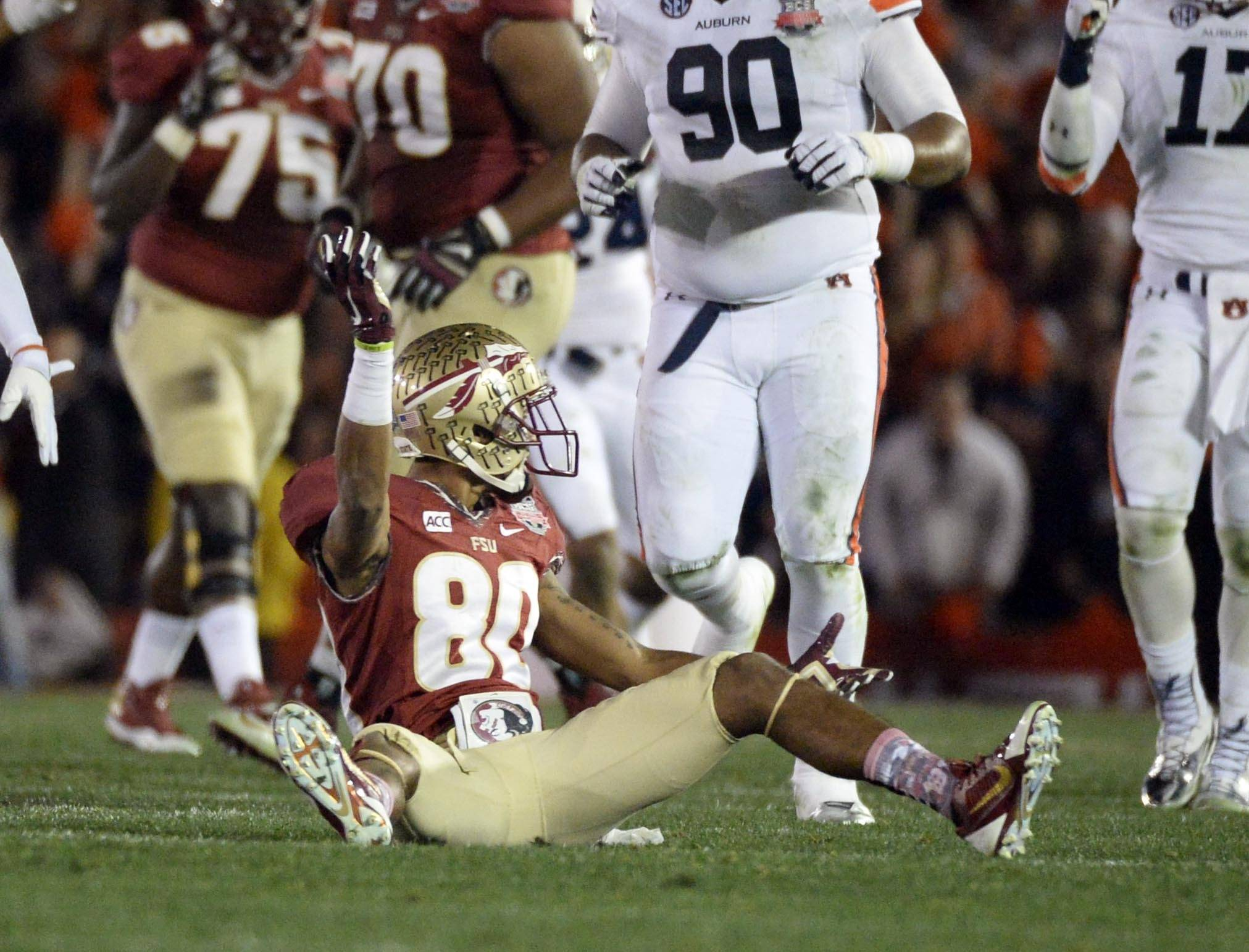 Jan 6, 2014; Pasadena, CA, USA; Florida State Seminoles wide receiver Rashad Greene (80) reacts after being tackled by Auburn Tigers cornerback Chris Davis (not pictured) during the first half of the 2014 BCS National Championship game at the Rose Bowl.  Mandatory Credit: Richard Mackson-USA TODAY Sports