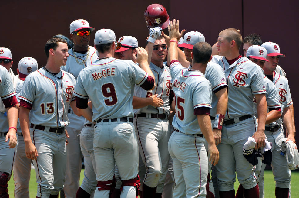 The Seminoles celebrate at home following Jayce Boyd's home run in the fifth.