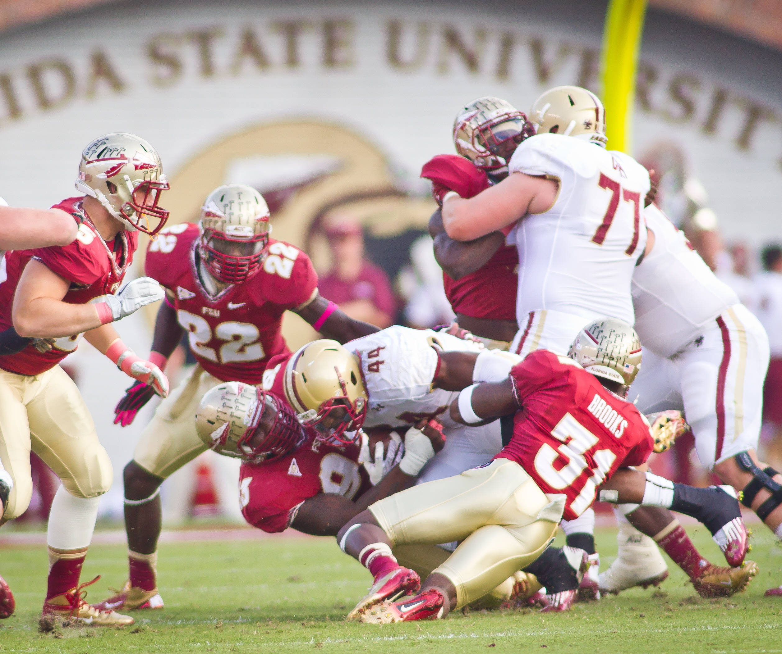 Everett Dawkins (93) and Terrence Brooks (31) bring down a BC runner.