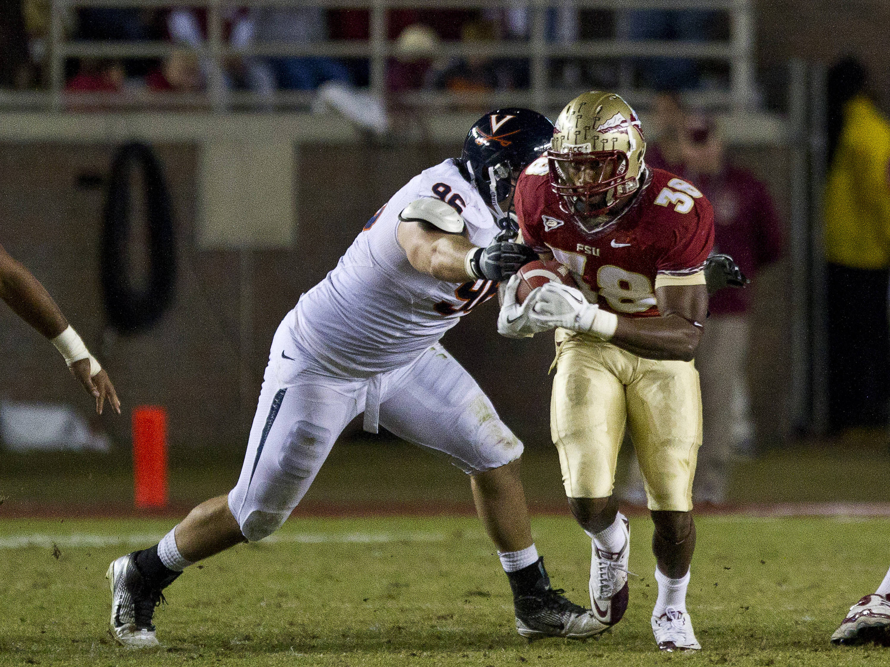 Jermaine Thomas (38) shakes off a defender during the game against Virginia on November 19, 2011.