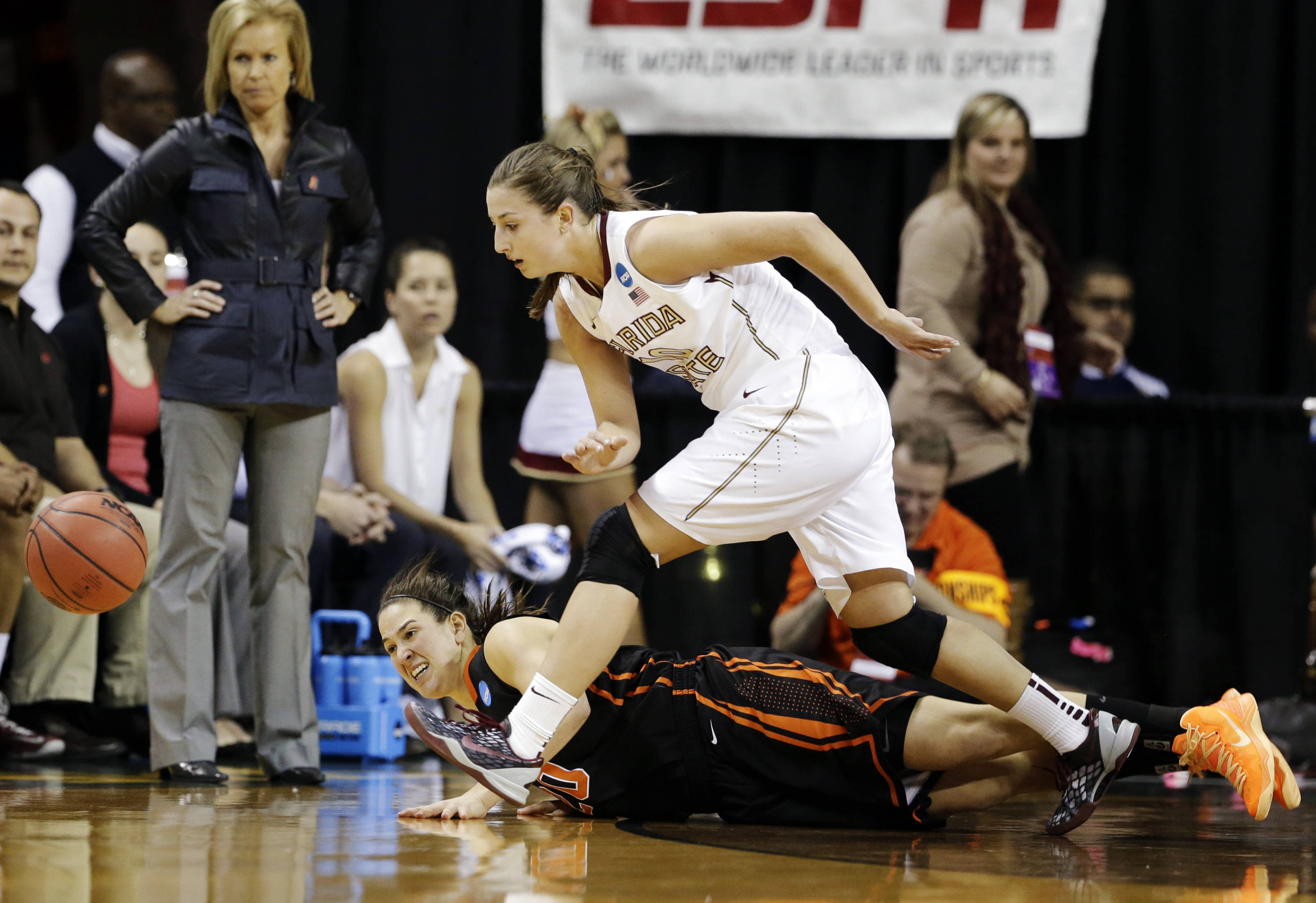 Florida State's Leonor Rodriguez (10) chases down a loose ball against Princeton's Kate Miller, bottom, as Florida State head coach Sue Semrau watches. (AP Photo/Tony Gutierrez)