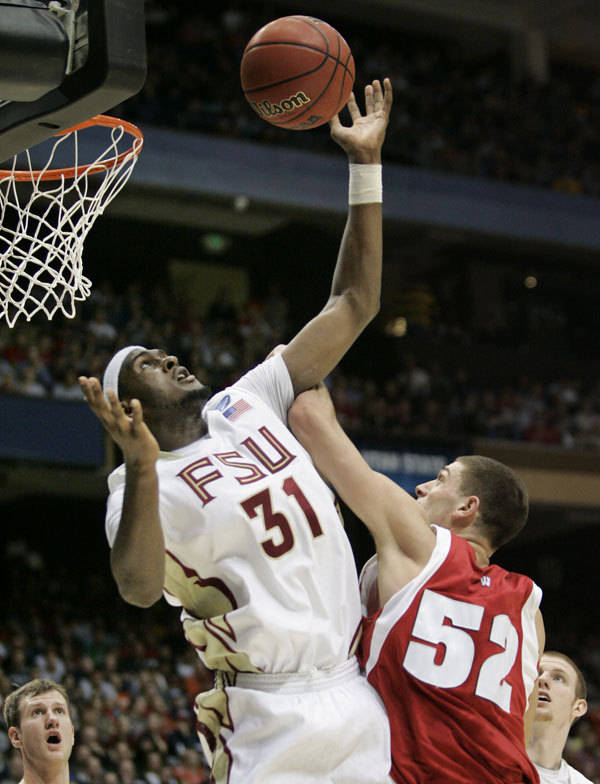 Florida State forward Chris Singleton (31) gets a rebound in front of Wisconsin forward Keaton Nankivil (52) in the first half.