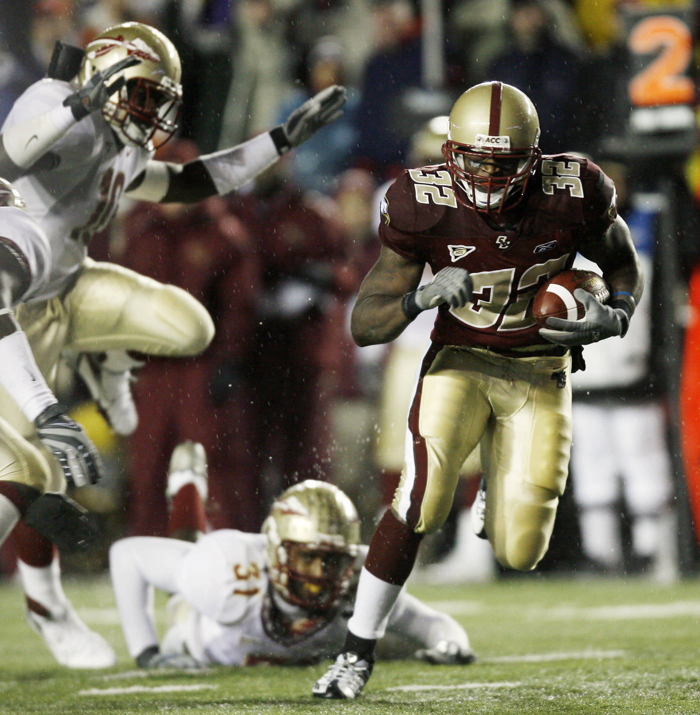 Boston College's Andre Callender (32) runs past Florida State's Toddrick Verdell (31) and Eugene Hayes (10) during the first half of a college football game in Boston Saturday, Nov. 3, 2007. (AP Photo/Winslow Townson)