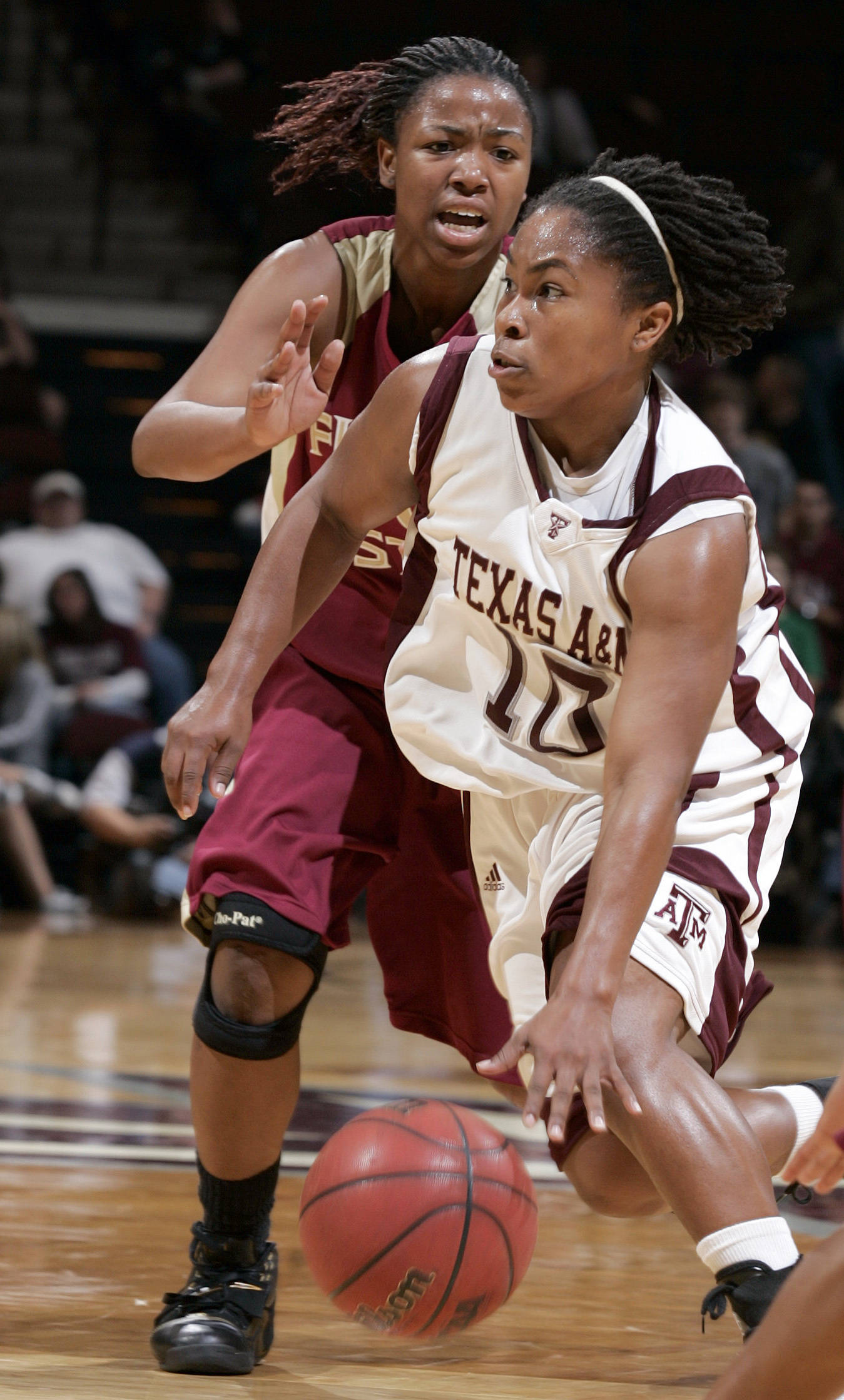 Texas A&M's A'Quonesia Franklin drives past Florida State's Angel Gray during the first half of a basketball game Thursday, Dec. 6, 2007, at Reed Arena in College Station, Texas. (AP Photo/Paul Zoeller)