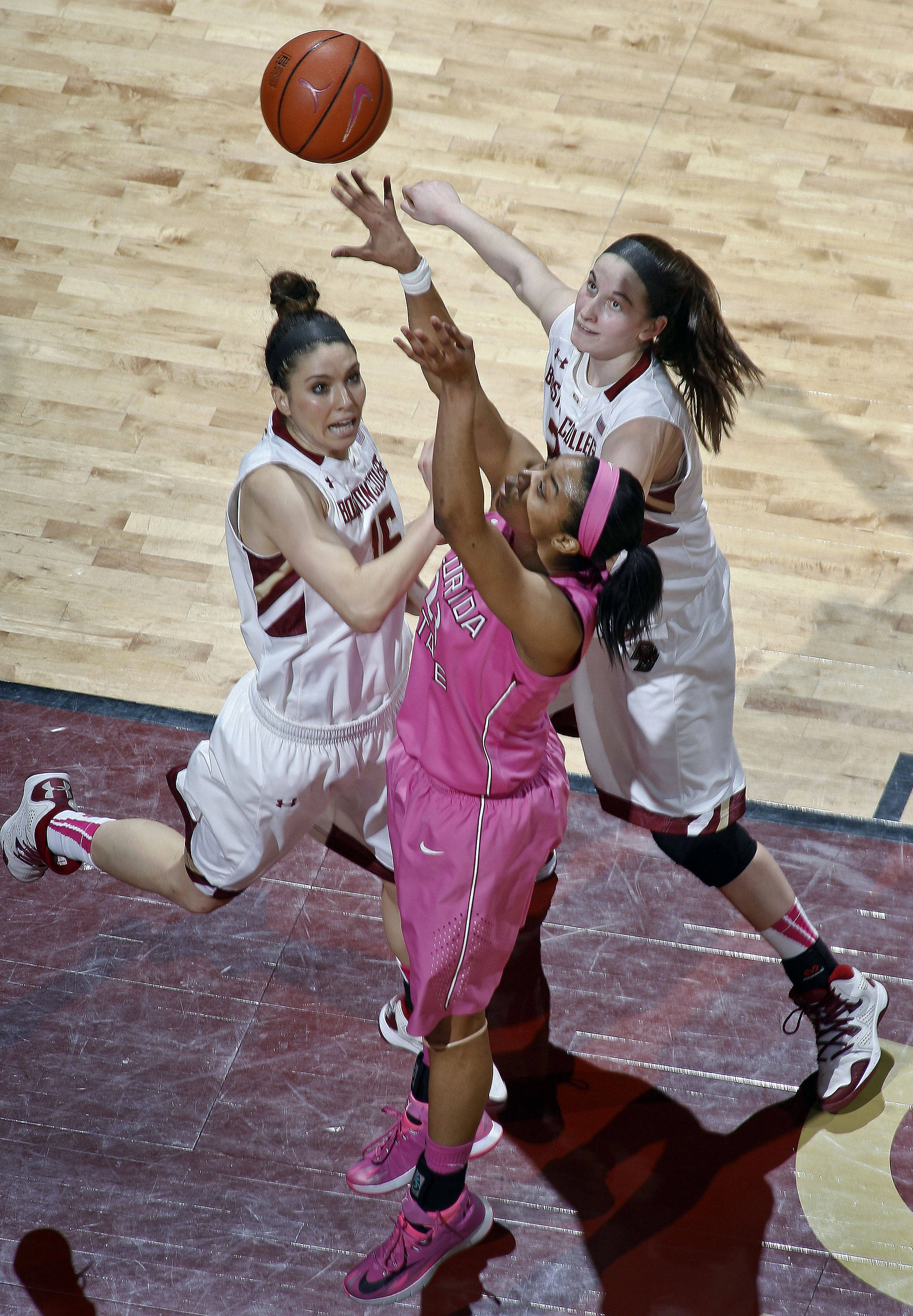 Florida State Seminoles forward Ivey Slaughter (23) shoots the ball as Boston College Eagles guards Lauren Engeln (15) and Kelly Hughes (23) defend. Mandatory Credit: Phil Sears-USA TODAY Sports