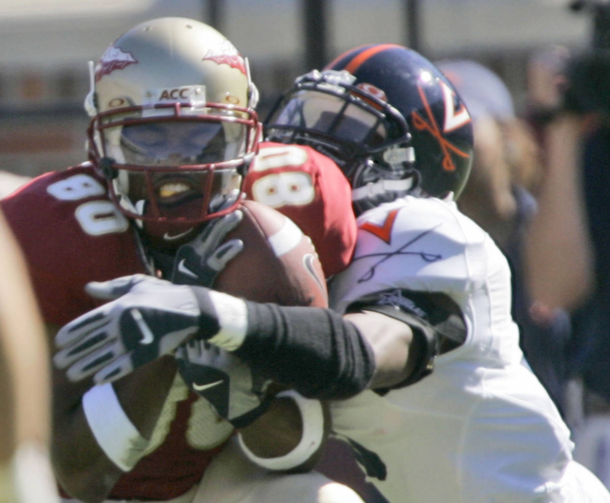 Virginia defender Marcus Hamilton, right, knocks the ball loose from Florida State receiver Joslin Shaw during the second quarter of a college football game, Saturday, Nov. 4, 2006, in Tallahassee, Fla. (AP Photo/Phil Coale)