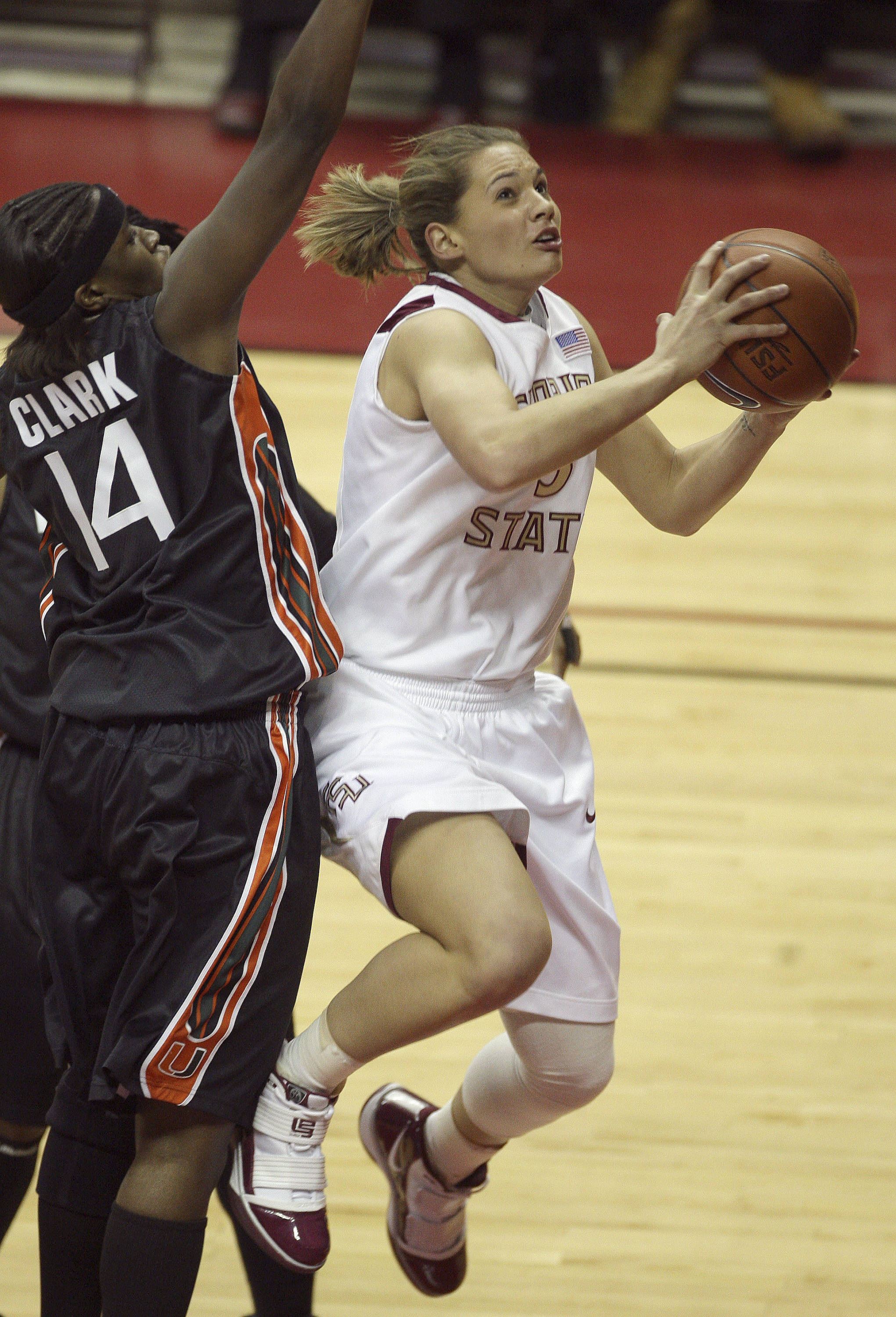 Florida State's Alexa Deluzio, right, drives to the basket as Miami's Charmaine Clark defends during an NCAA college basketball game Thursday, Feb. 25, 2010, in Tallahassee, Fla. (AP Photo/Phil Coale)