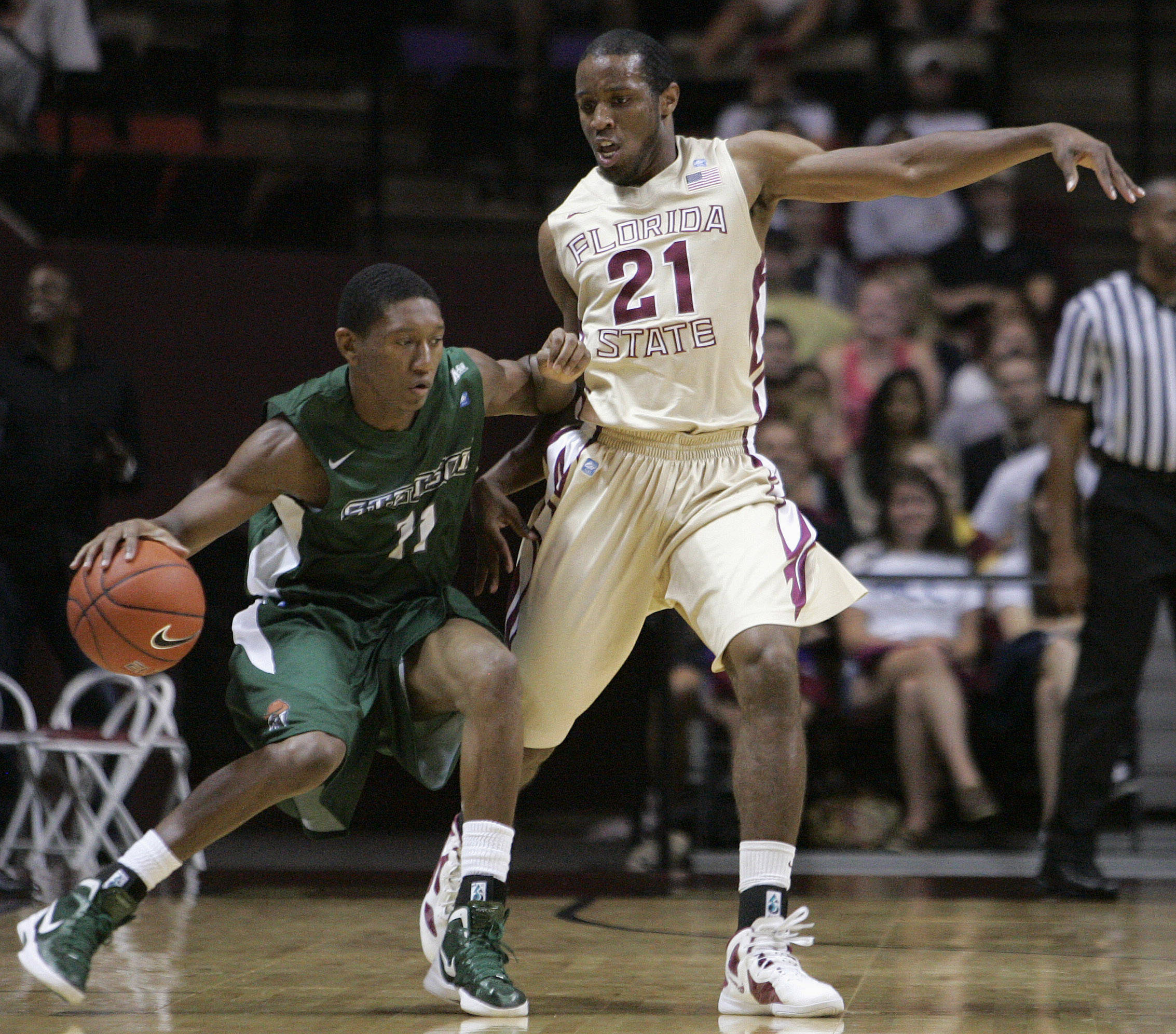Florida State's Michael Snaer defends Stetson's Aaron Graham. (AP Photo/Steve Cannon)