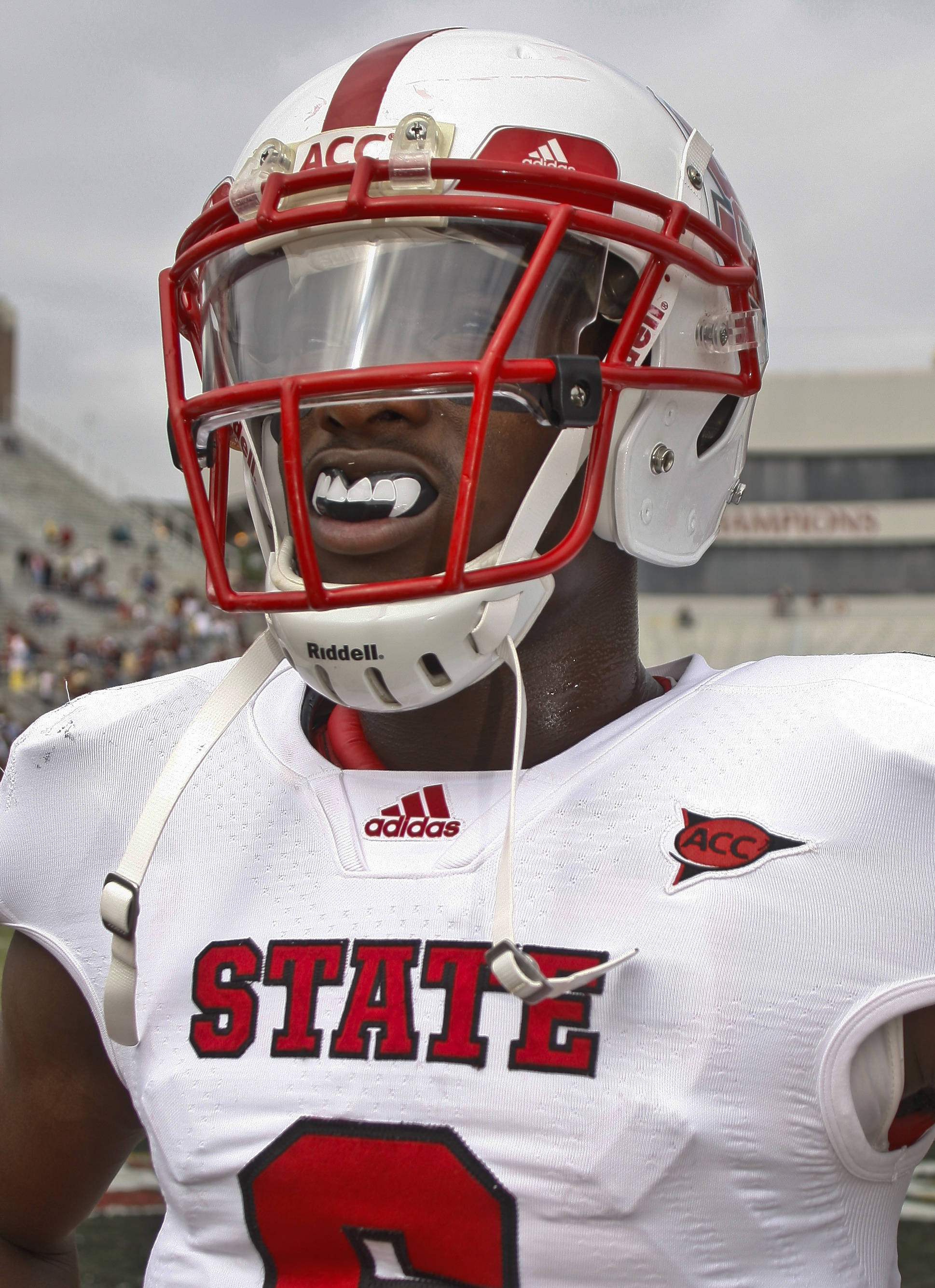 North Carolina State wide receiver T.J. Graham wears a vampire-like mouth protector before the start of an NCAA college football game against Florida State at Doak Campbell Stadium in Tallahassee, Fla., Saturday, Oct. 29, 2011. (AP Photo/Phil Sears)