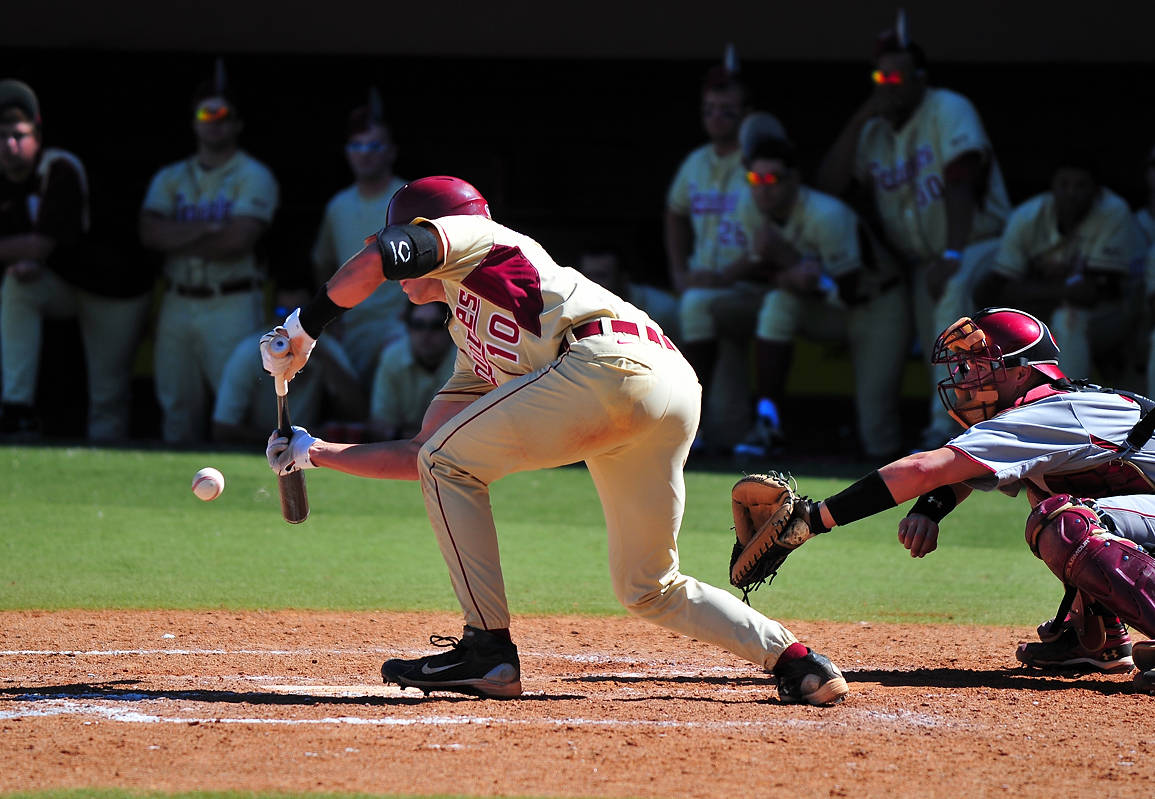Two walks and this Justin Gonzalez sacrifice bunt set the plate for FSU's game-winning run in the bottom of the ninth.
