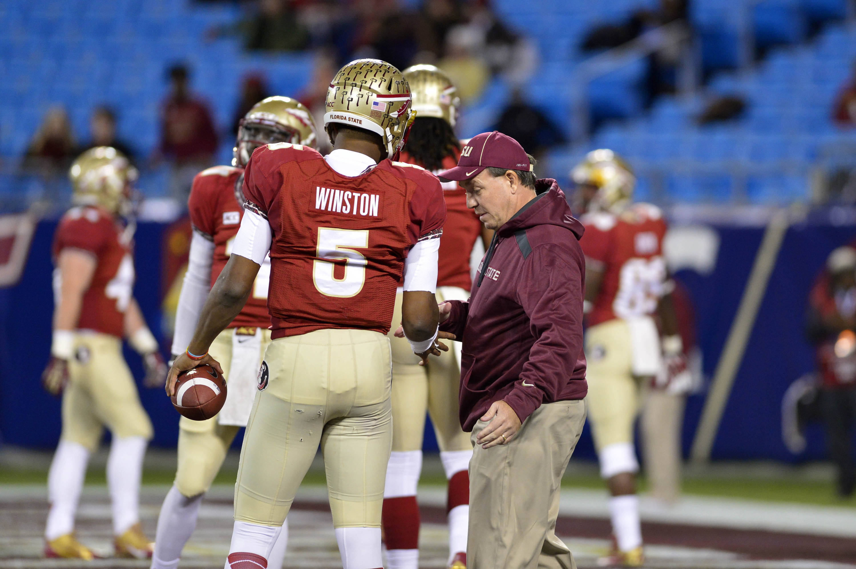 Dec 7, 2013; Charlotte, NC, USA; Florida State Seminoles head coach Jimbo Fisher shakes quarterback Jameis Winston (5) before the game at Bank of America Stadium. Mandatory Credit: Bob Donnan-USA TODAY Sports