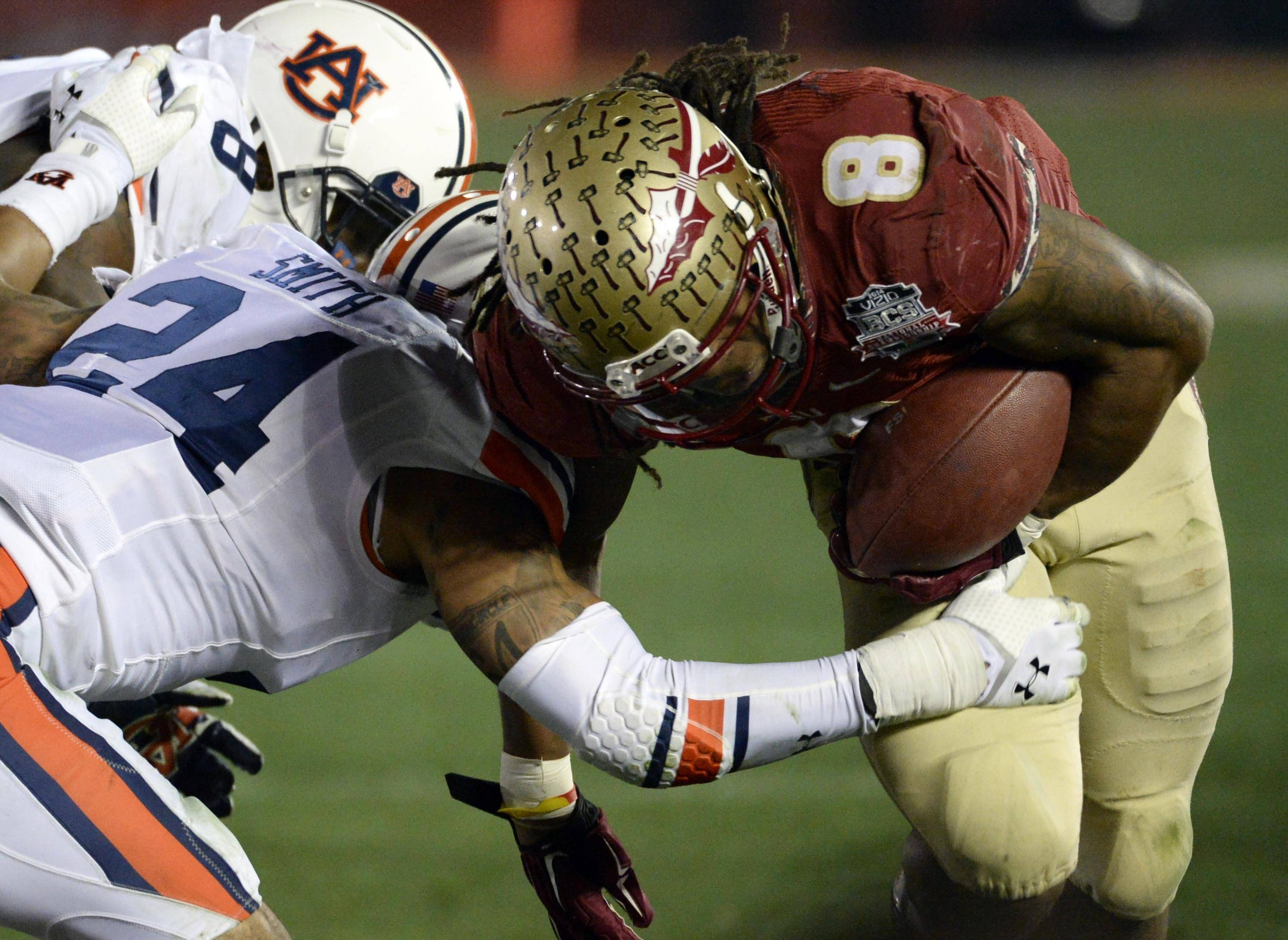 Jan 6, 2014; Pasadena, CA, USA; Auburn Tigers defensive back Ryan Smith (24) forces Florida State Seminoles running back Devonta Freeman (8) out of bounds during the second half of the 2014 BCS National Championship game at the Rose Bowl.  Mandatory Credit: Richard Mackson-USA TODAY Sports