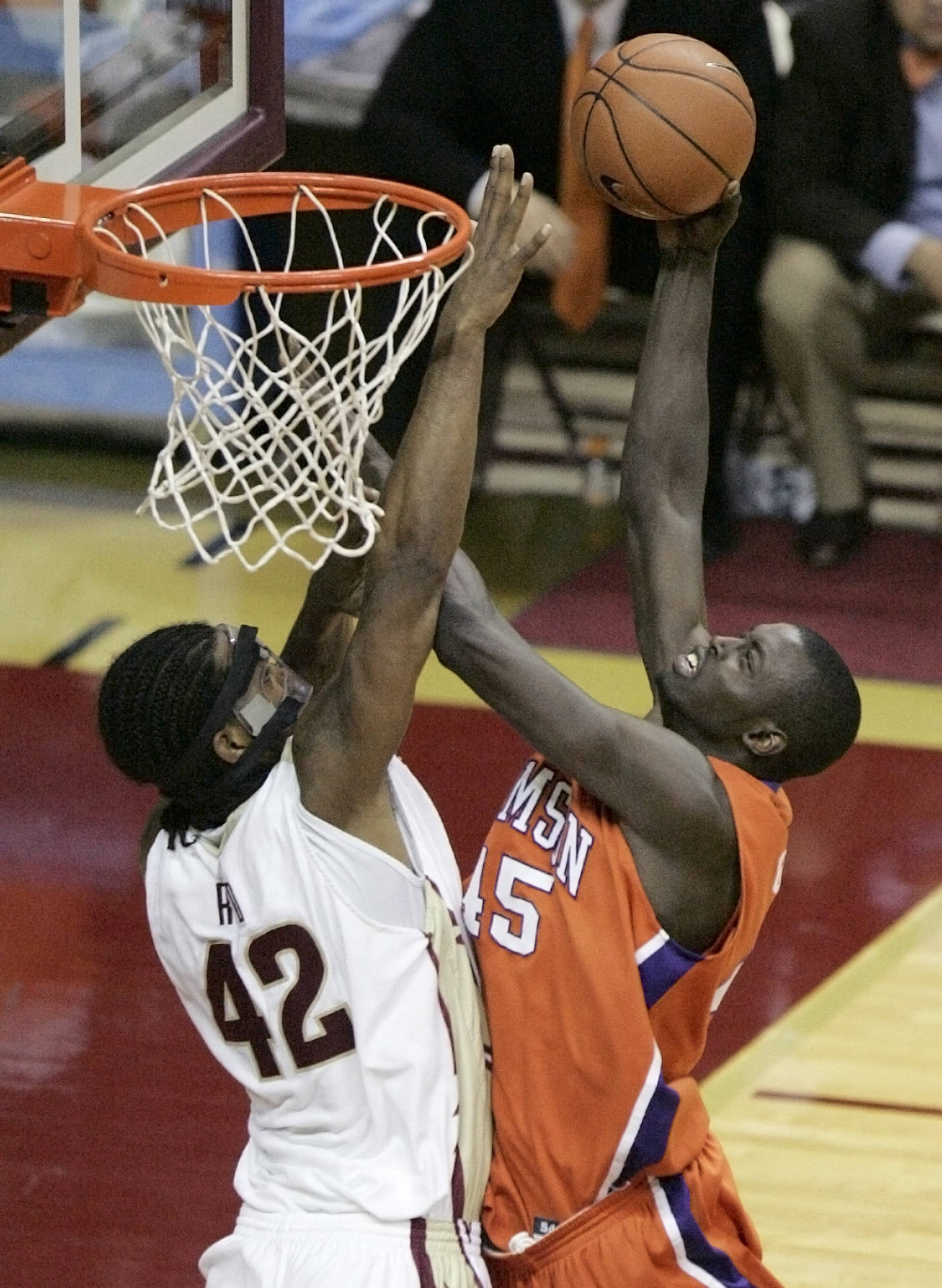 Clemson's Jerai Grant, right, is fouled by Florida State's Ryan Reid while driving to the basket in the second half of Florida State's 64-55 win in a basketball game Tuesday, Feb. 19, 2008, in Tallahassee, Fla. (AP Photo/Steve Cannon)