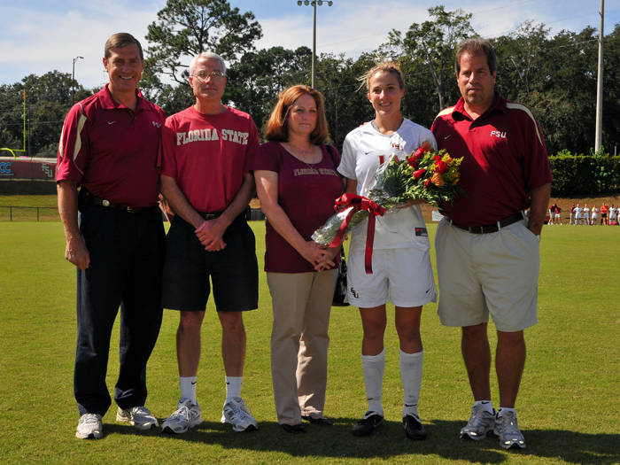 Senior Becky Edwards with her parents, head coach Mark Krikorian and Athletics Director Randy Spetman
