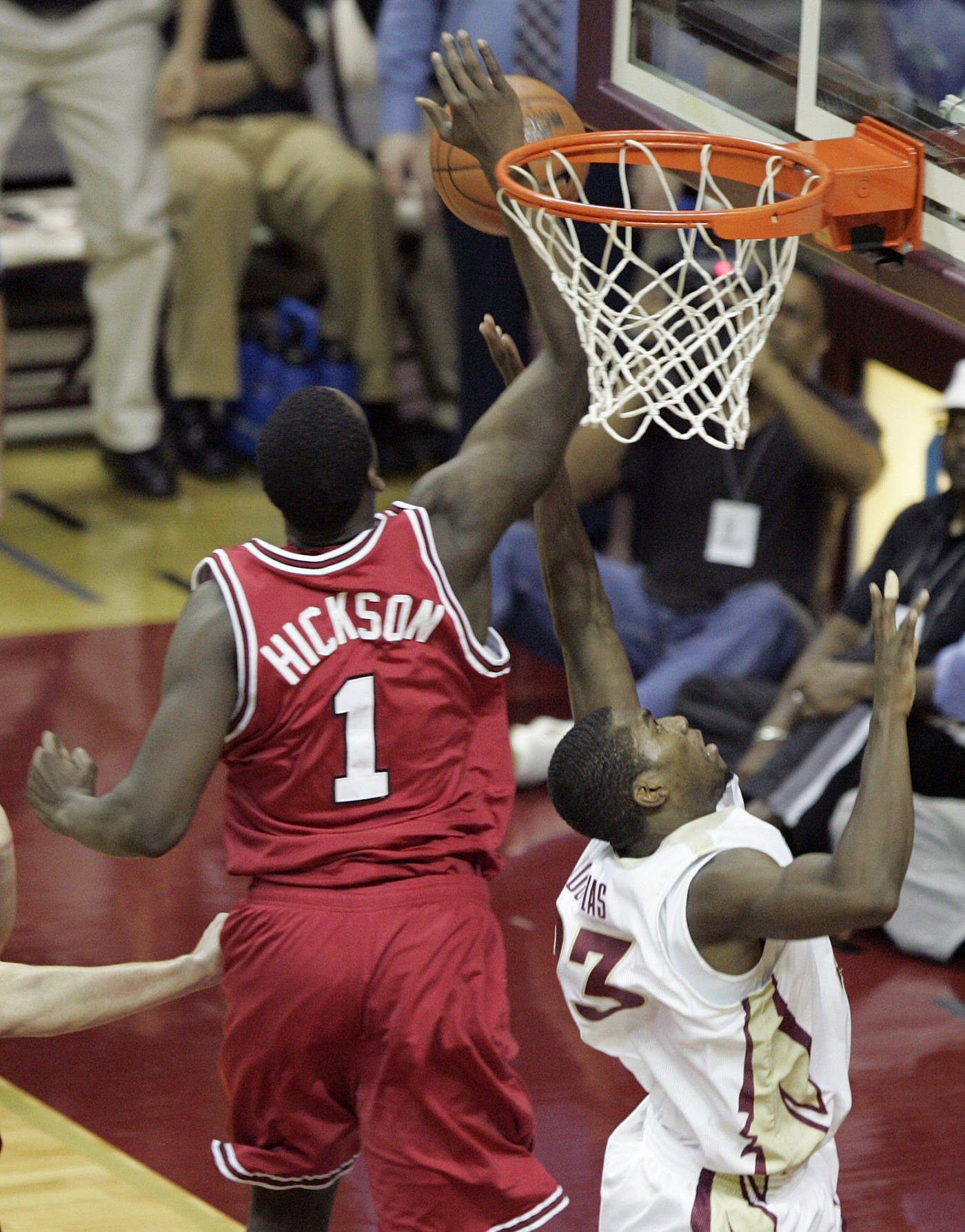 North Carolina State's J J Hickson (1) blocks a shot by Florida State's Toney Douglas that would have tied the score in the final seconds of the second half of a college basketball game on Saturday, Jan. 26, 2008 in Tallahassee, Fla. NC State hold on for a 69-66 win.