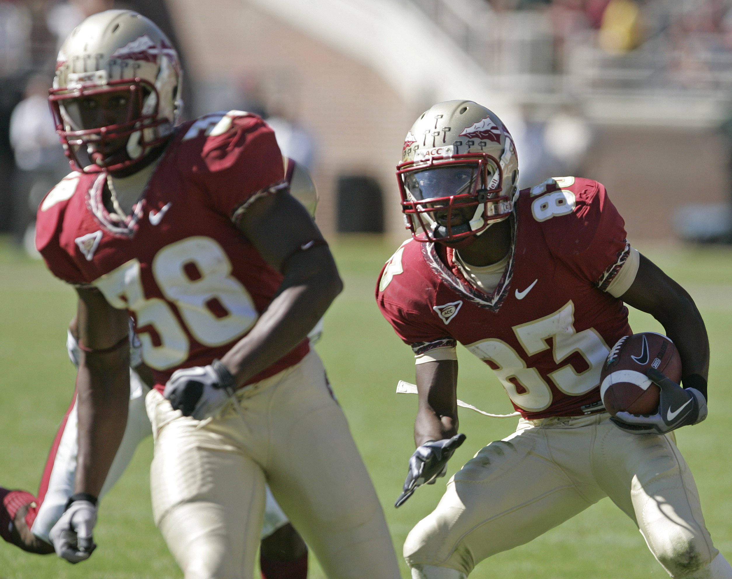 Florida State's Burt Reed, right, follows the block of Jermaine Thomas on his way to the game-winning touchdown on Saturday. (AP Photo/Steve Cannon)