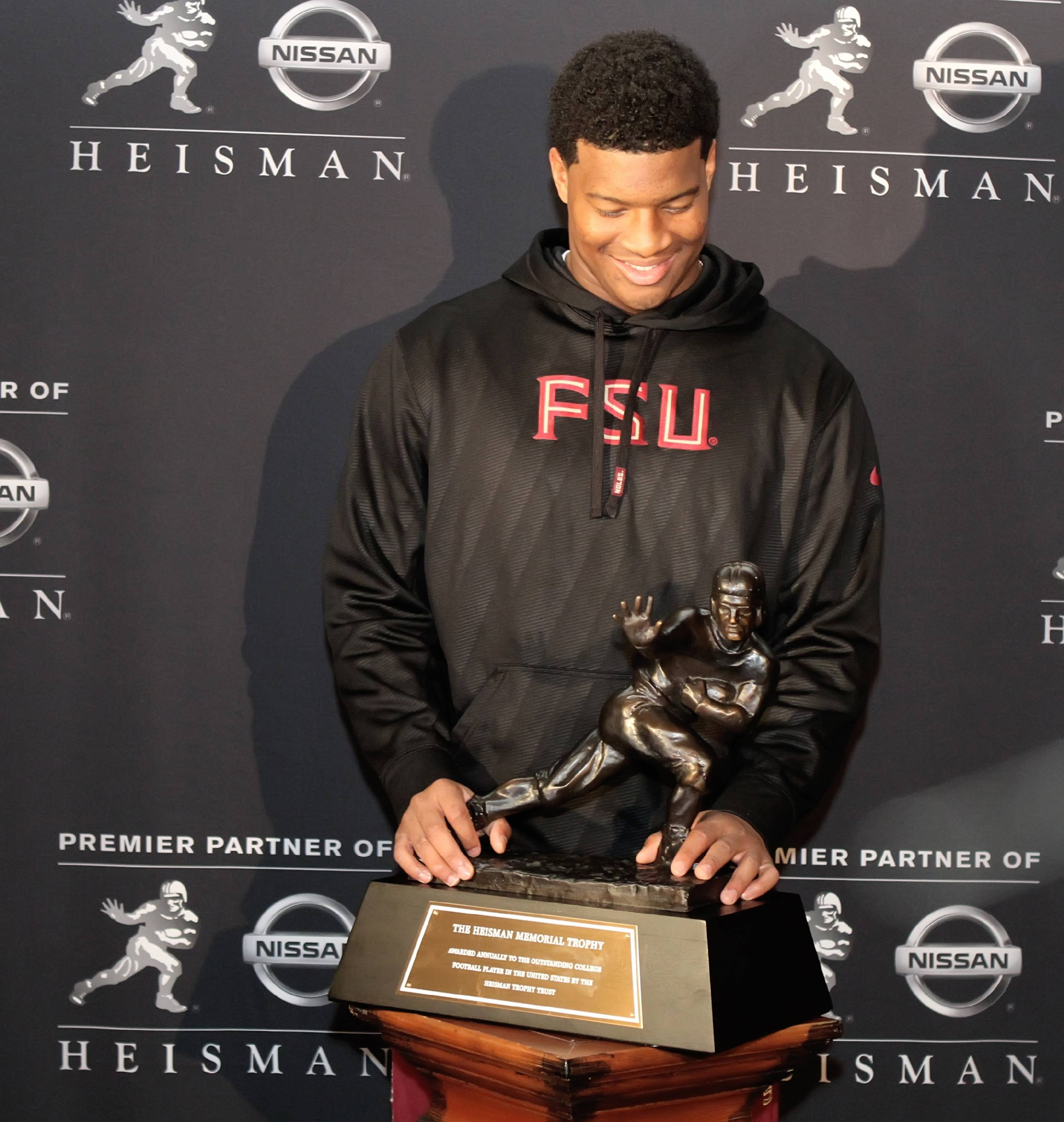 Jameis Winston with the Heisman Trophy
