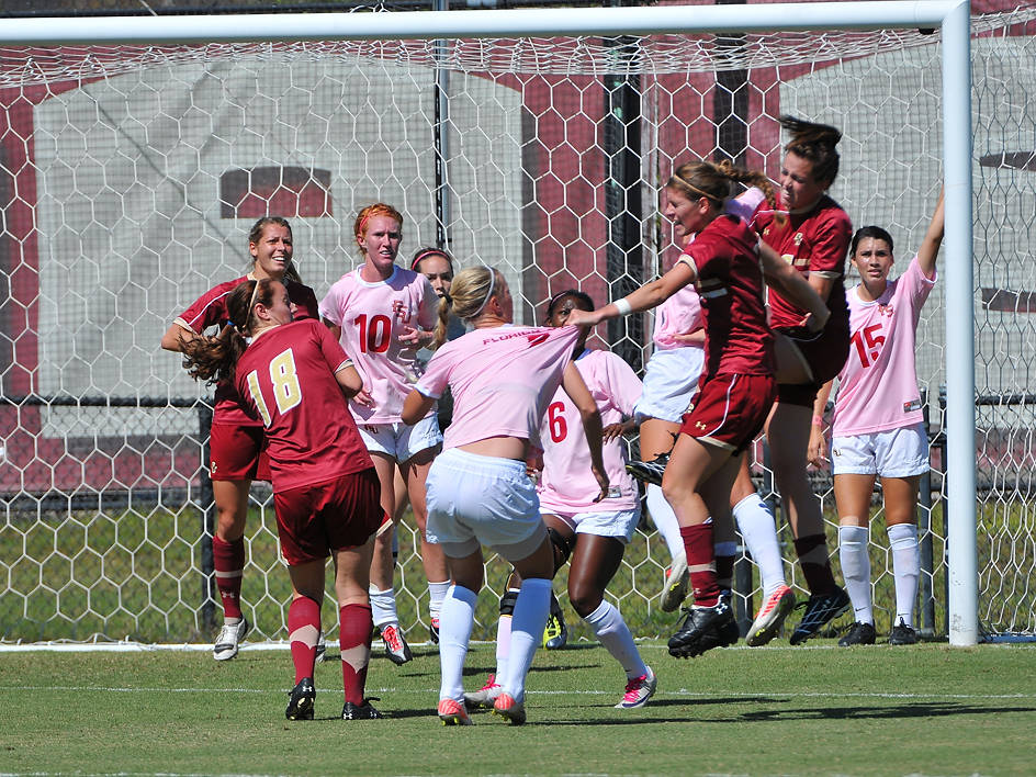 The two teams battle it out in the box following a BC corner kick.