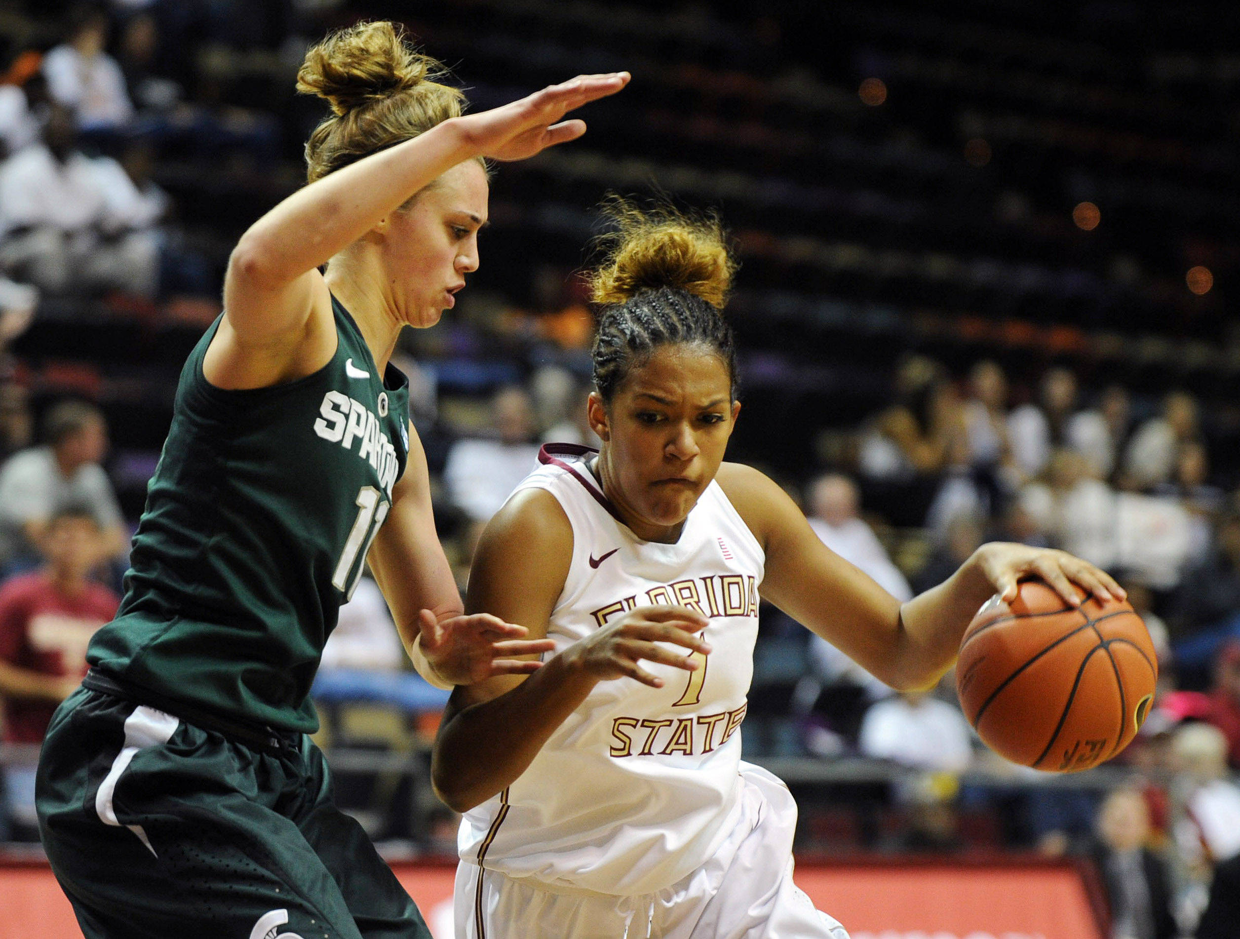Dec 4, 2013; Tallahassee, FL, USA; Florida State Seminoles guard Morgan Jones (1) moves past Michigan State Spartans forward Annalise Pickrel (11) during the game at the Donald L. Tucker Center. Mandatory Credit: Melina Vastola-USA TODAY Sports