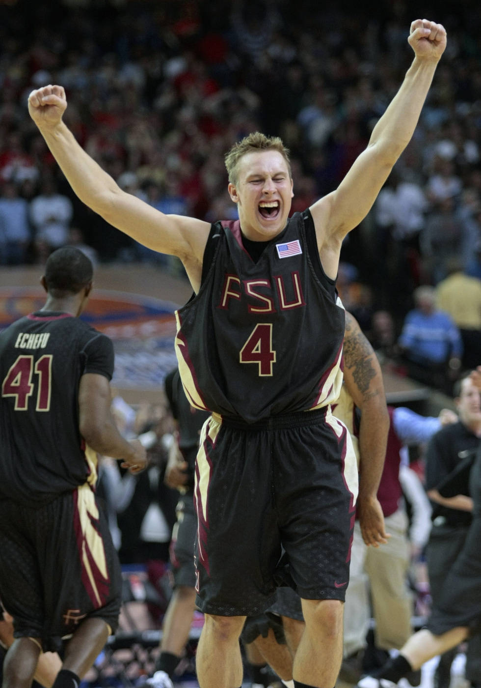 Florida State guard Deividas Dulkys (4) celebrates their 73-70 victory over No. 1 North Carolina during an NCAA college basketball game in the semifinals of the Atlantic Coast Conference men's tournament in Atlanta, Saturday, March 14, 2009. (AP Photo/Dave Martin)