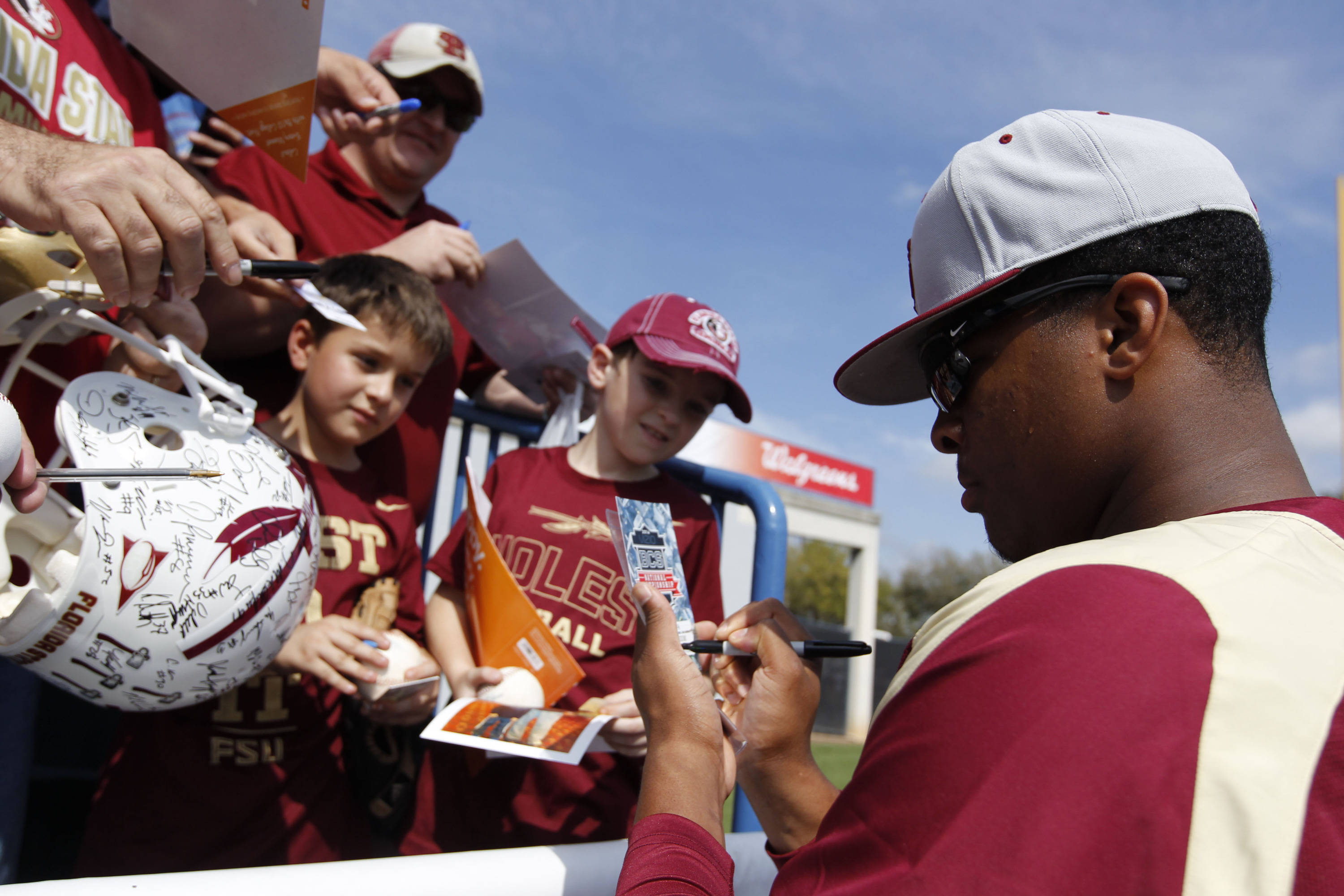 Feb 25, 2014; Tampa, FL, USA; Florida State Seminoles pitcher/outfielder Jameis Winston (44) signs autographs prior to the game against the New York Yankees at George M. Steinbrenner Field. Mandatory Credit: Kim Klement-USA TODAY Sports