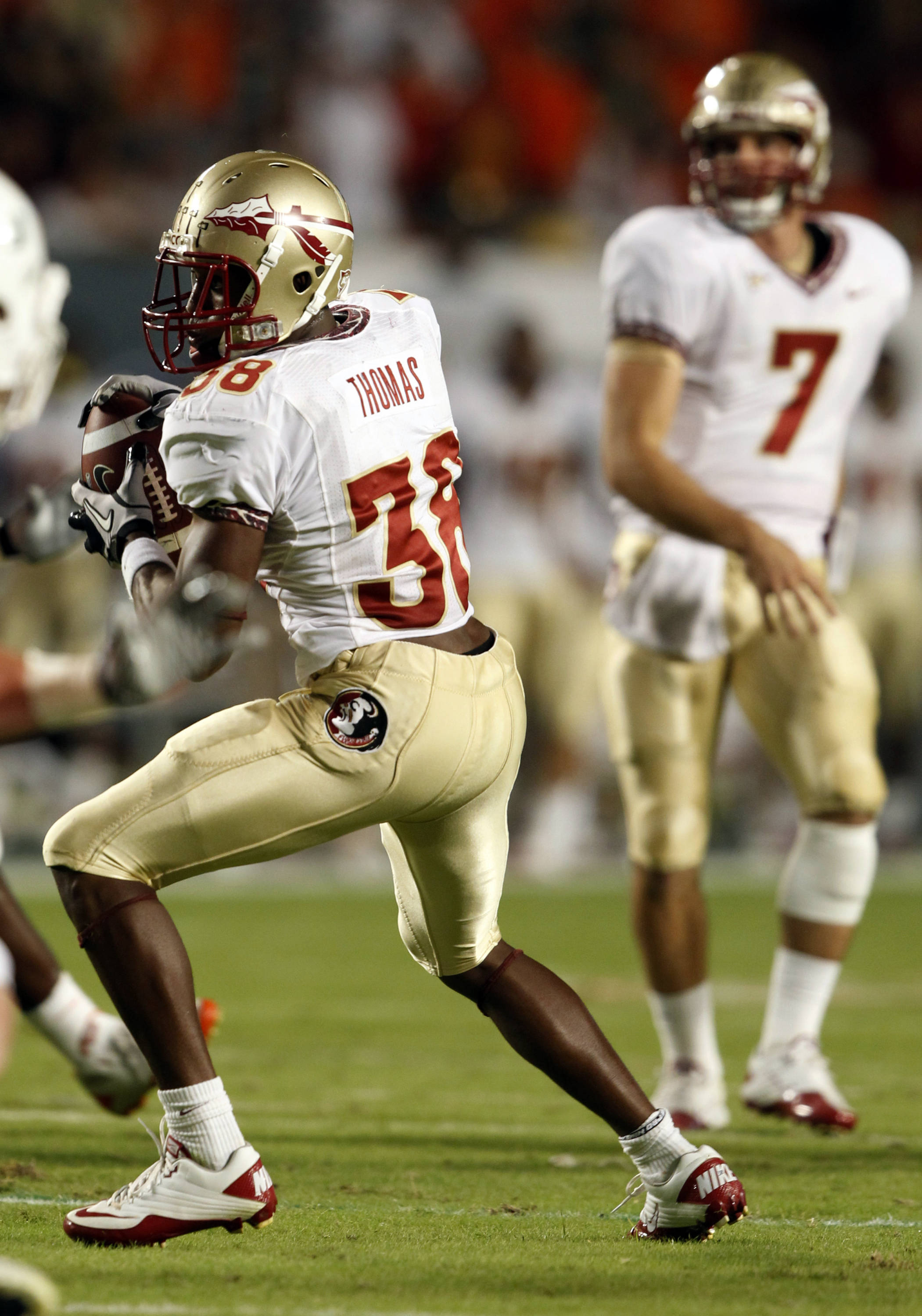 Florida State Seminoles running back Jermaine Thomas makes a catch on a pass from quarterback Christian Ponder.