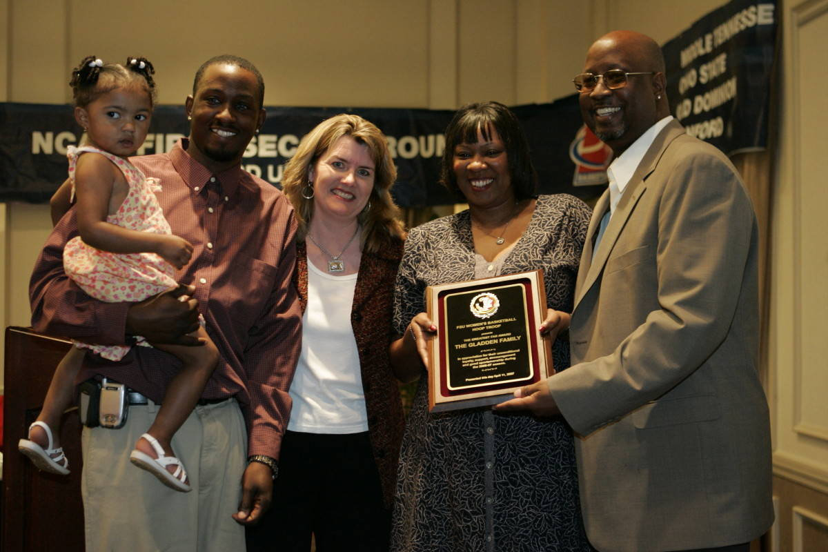 The Gladden Family received the Fan of the Year Award presented by Hoop Troop President Yvonne Sherron.