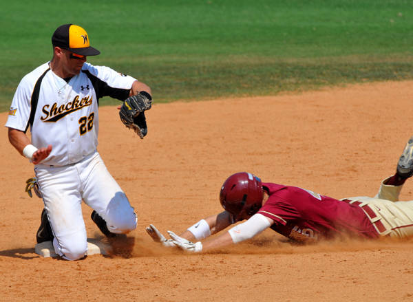 Jack Rye slides safely into second base