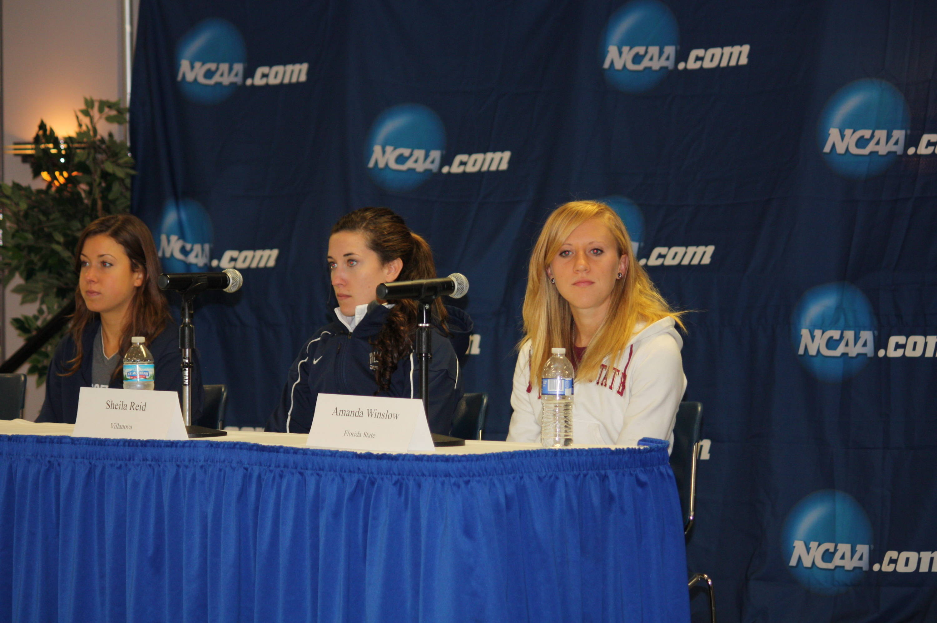FSU's Amanda Winslow, right, is joined by Villanova's Sheila Reid and Georgetown's Emily Infeld at Sunday's NCAA Cross Country Championship press conference.