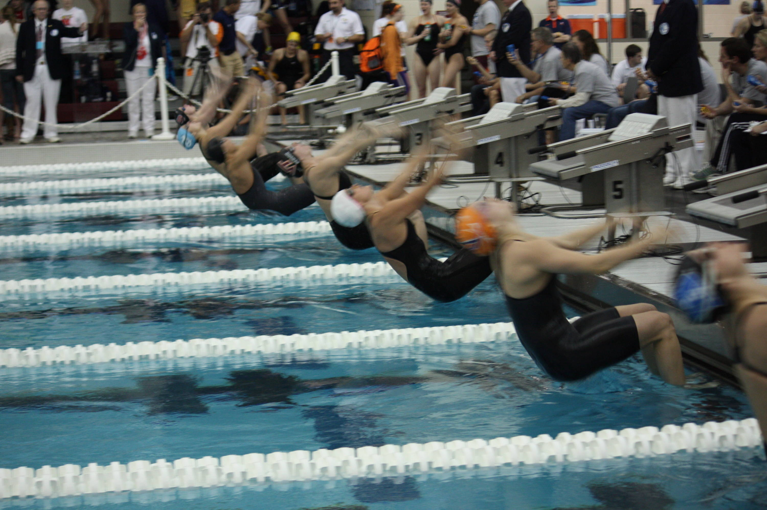 Senior Stephanie Sarandos (white cap) swam in the consolation heat of the 100 back.