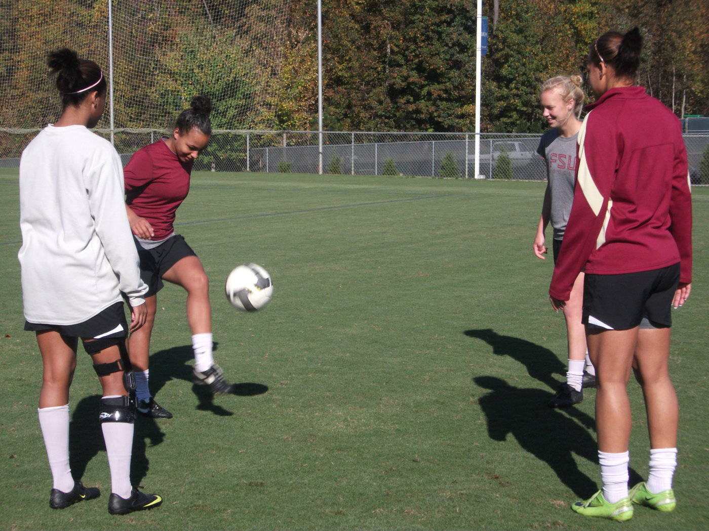 Ines Jaurena, Casey Short, Toni Pressley and Ella Stephan working out during practice.
