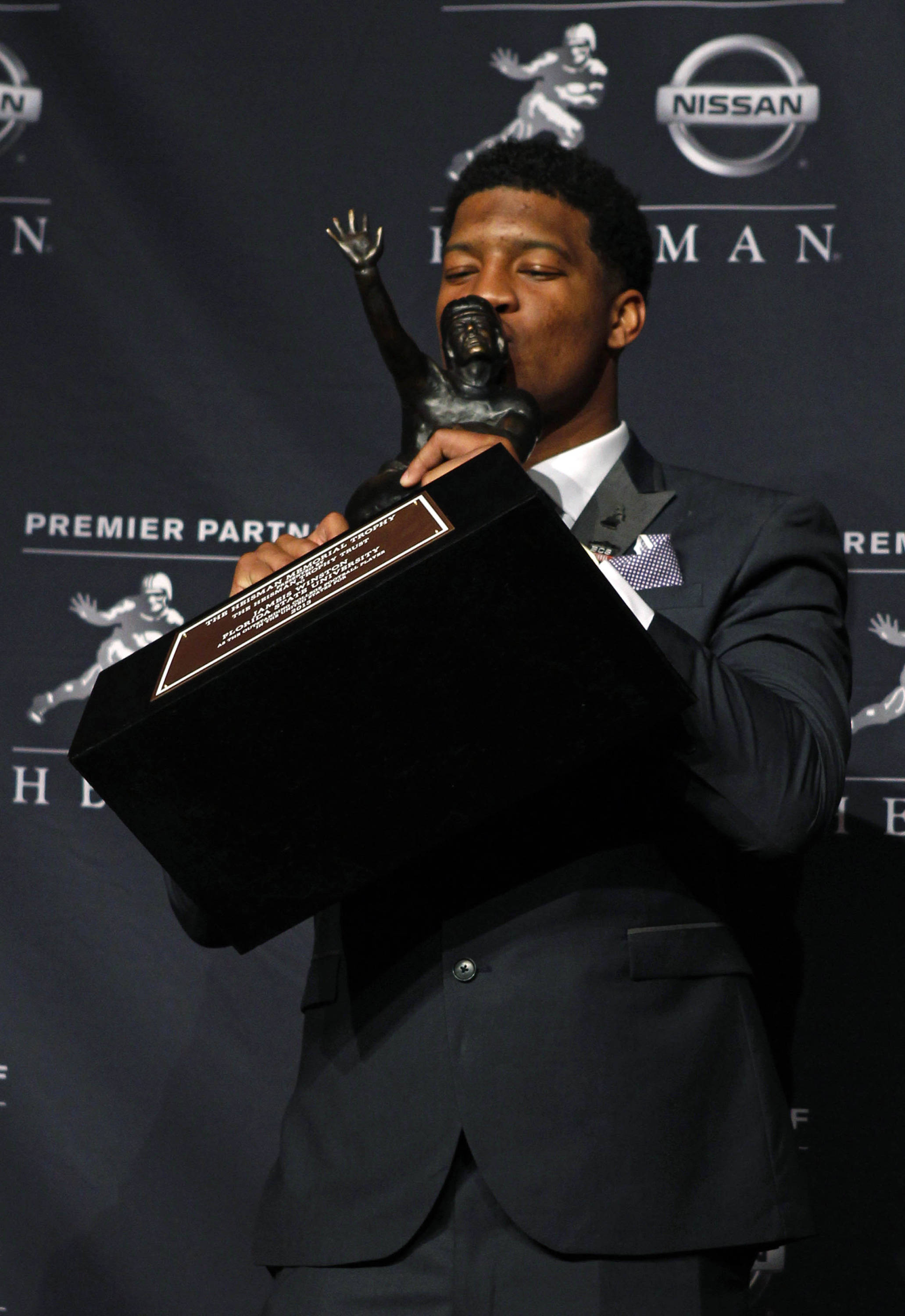 Dec 14, 2013; New York, NY, USA; Seminoles quarterback Jameis Winston kisses the trophy after being awarded the 2013 Heisman Trophy. Adam Hunger-USA TODAY Sports