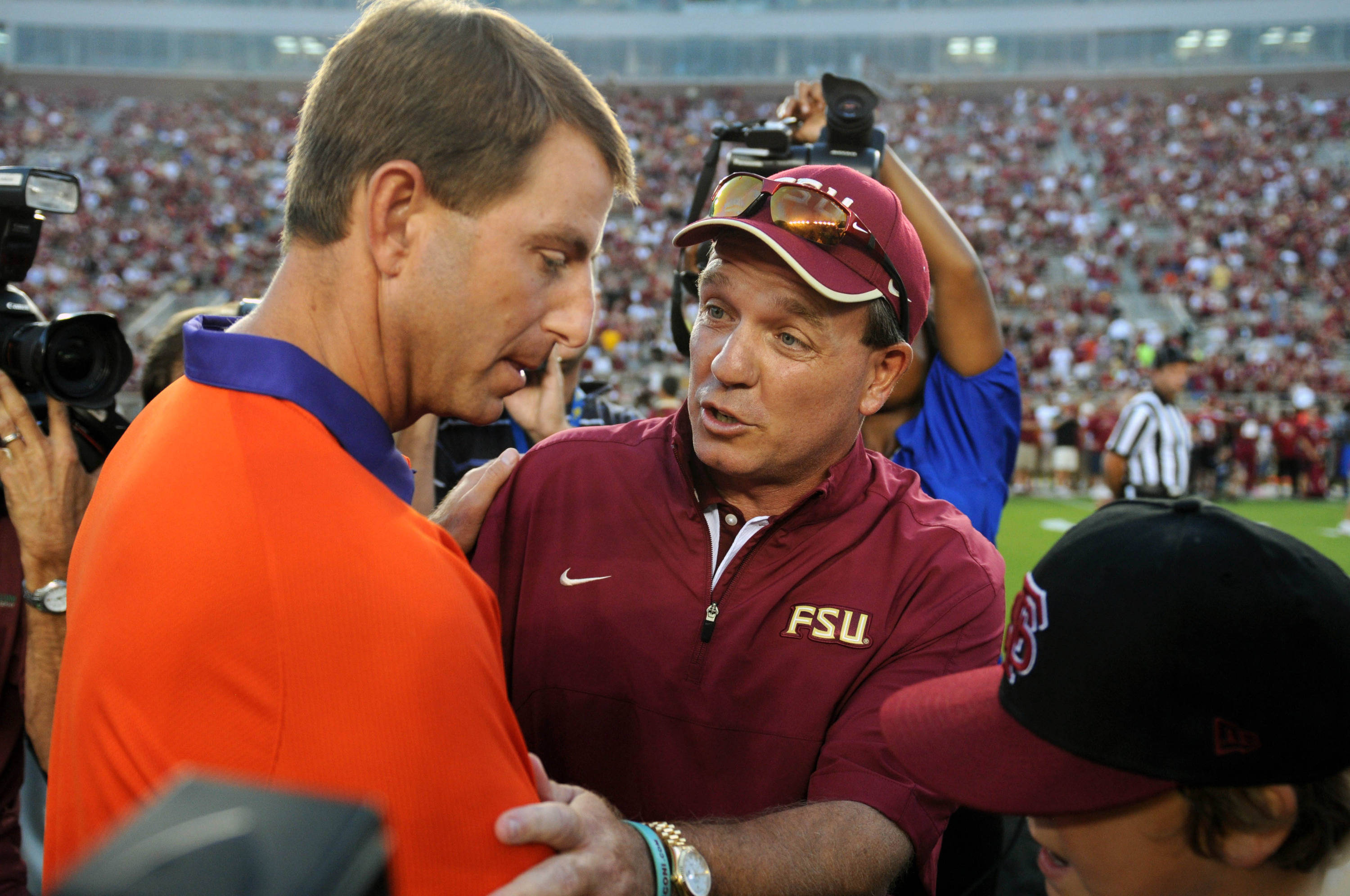 Sept 22, 2012;  Tallahassee, Florida, USA; Florida State Seminoles head coach Jimbo Fisher meets with Clemson Tigers head coach Dabo Swinney before the game at Doak Campbell Stadium. Mandatory Credit: Melina Vastola-USA TODAY Sports
