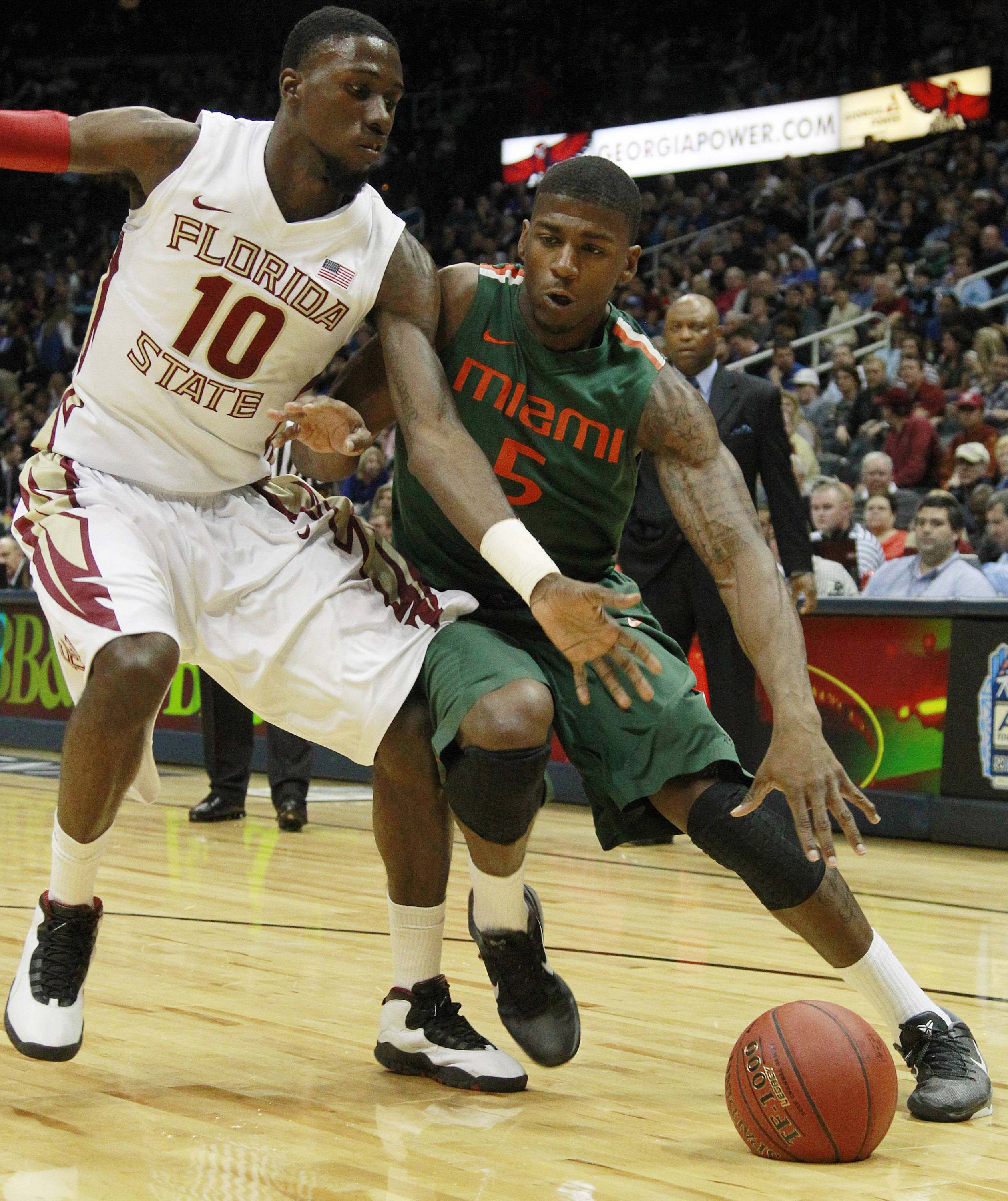 Miami guard/forward DeQuan Jones (5) works against Florida State forward Okaro White (10) during the first half of an NCAA college basketball game in the quarterfinals of the Atlantic Coast Conference tournament, Friday, March 9, 2012, in Atlanta. (AP Photo/John Bazemore)
