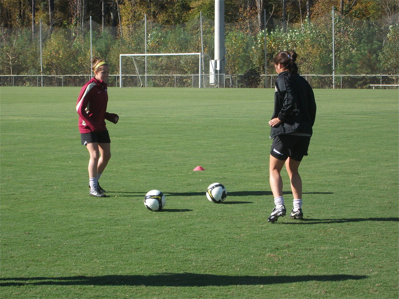 Amanda DaCosta and Rachel Lim working on a passing drill