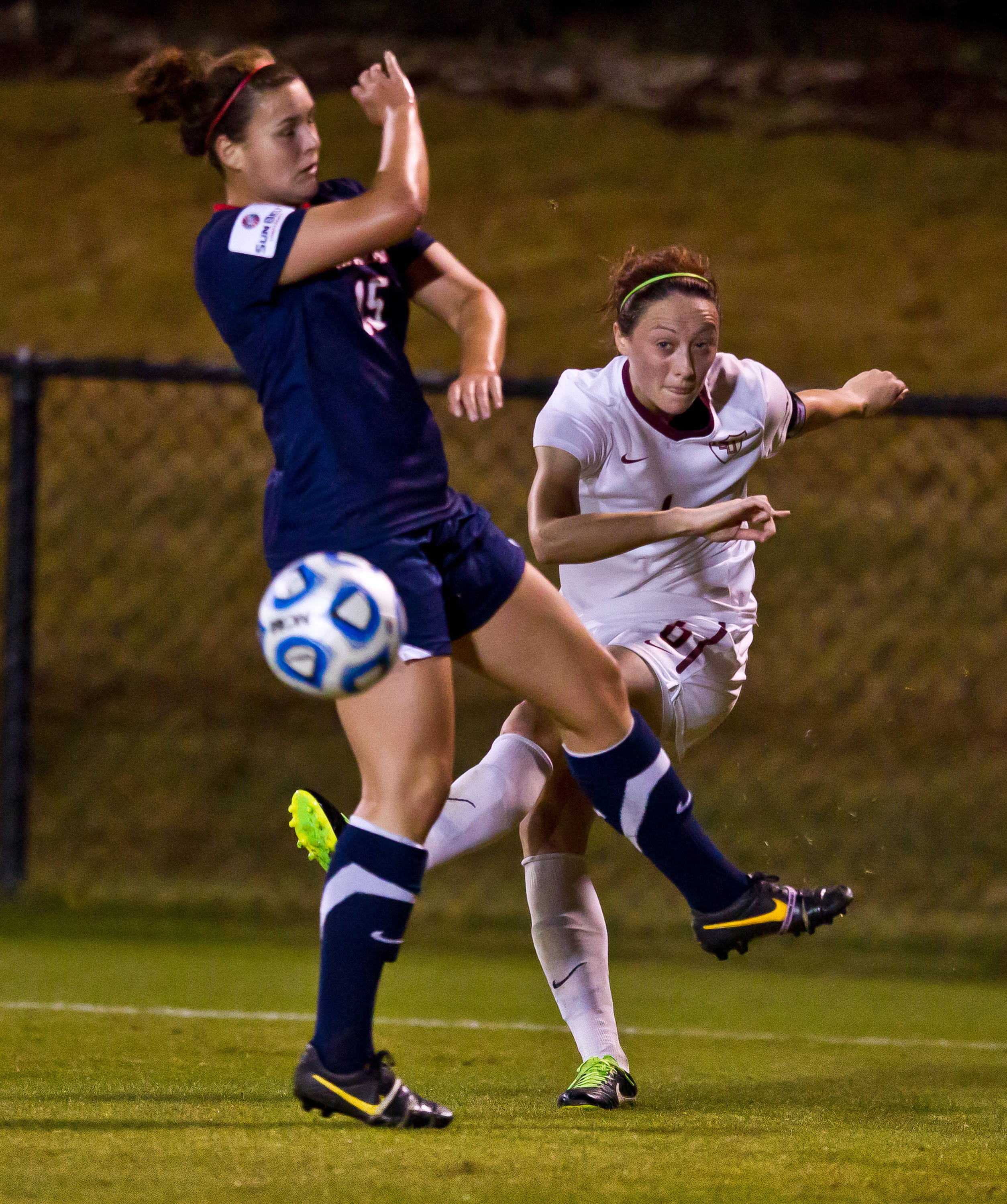 Megan Campbell (6) with a centering pass.