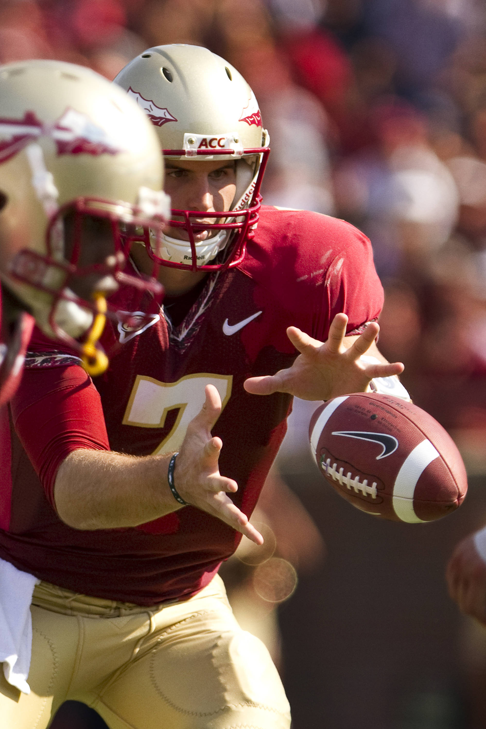 Christian Ponder (7) receives the snap in the first half