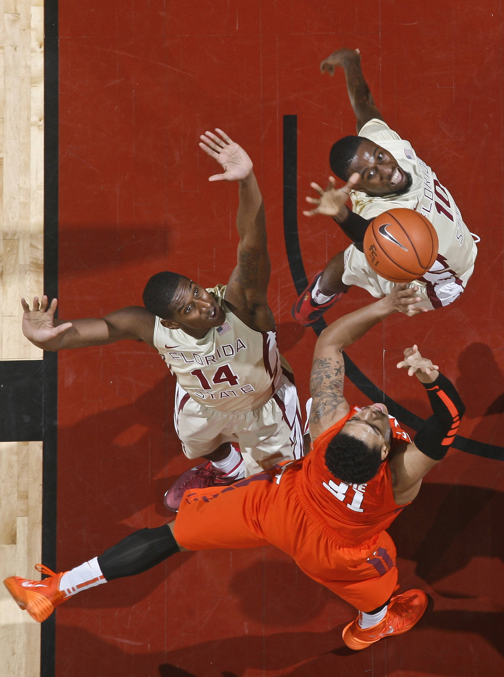 Feb 5, 2014; Tallahassee, FL, USA; Seminoles forward Okaro White (10) blocks the shot of Virginia Tech Hokies forward Jarell Eddie (31) in the first half. Phil Sears-USA TODAY Sports