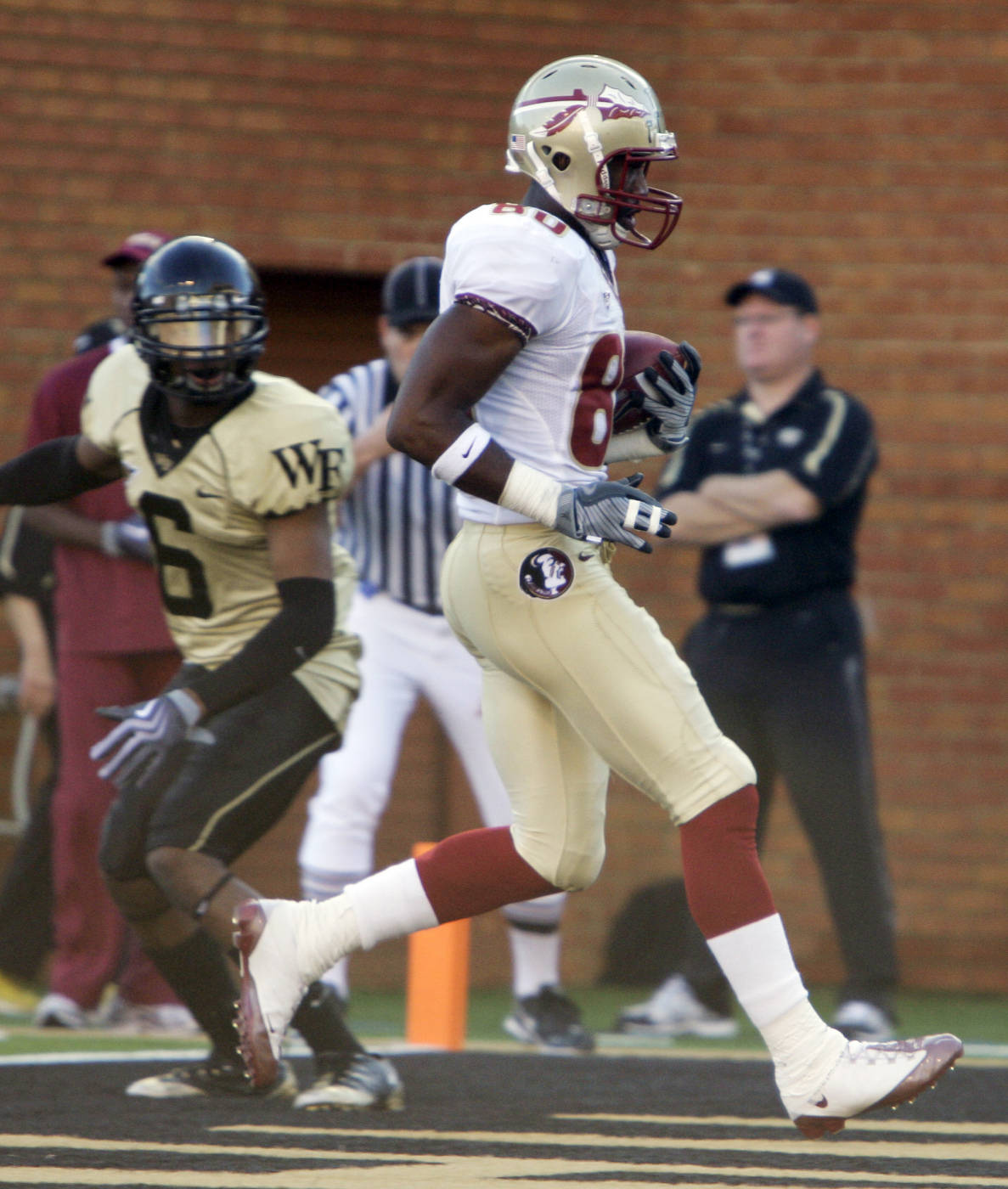 Florida State's Jarmon Fortson (80) runs into the end zone for a touchdown as Wake Forest's Kenny Okoro (6) looks on during the second half of an NCAA college football game in Winston-Salem, N.C., Saturday, Nov. 14, 2009. Florida State won, 41-28. (AP Photo/Chuck Burton)