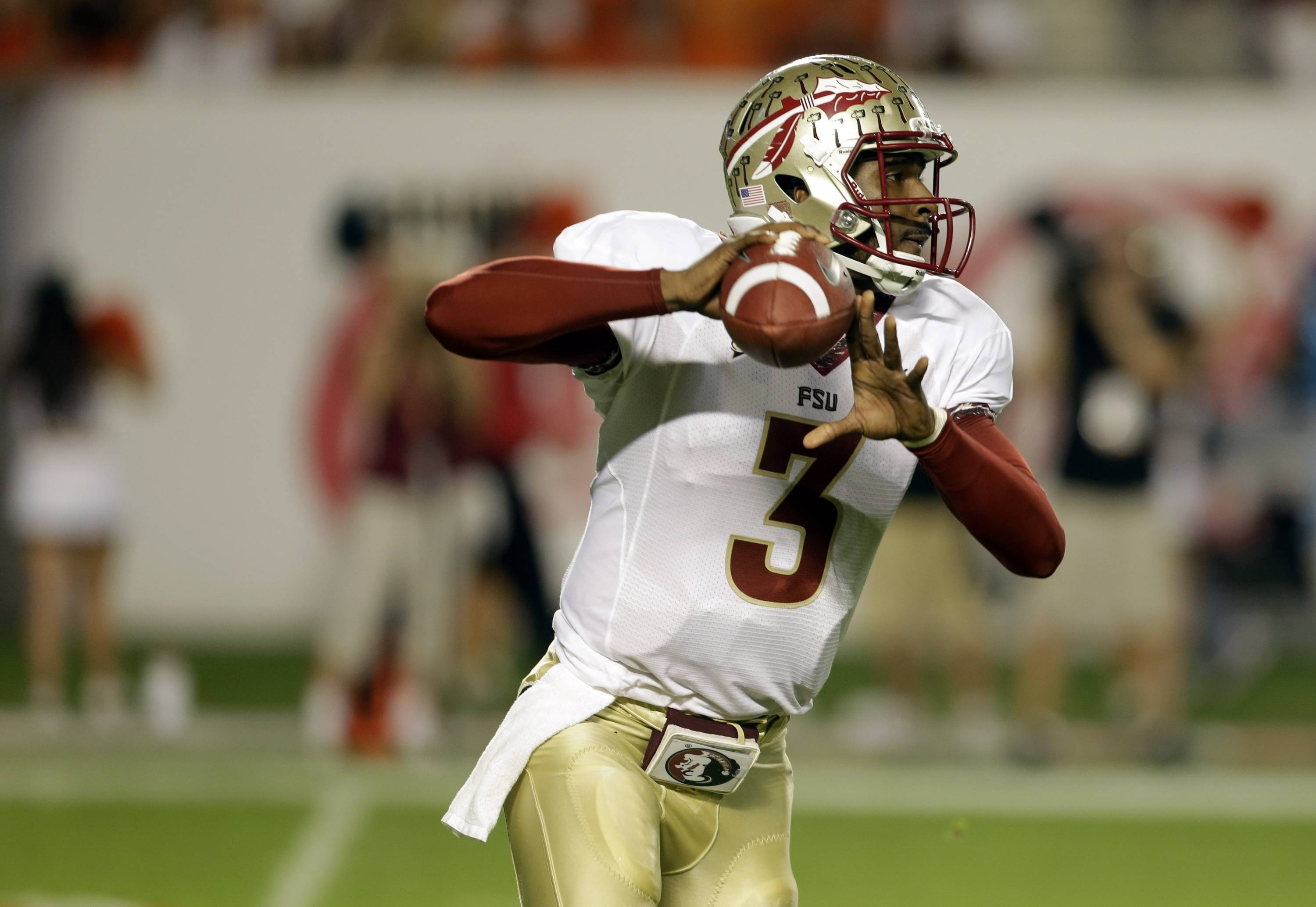 Florida State quarterback EJ Manuel (3) stands back to pass during the first half of an NCAA college football game against Miami, Saturday, Oct. 20, 2012, in Miami. (AP Photo/Lynne Sladky)