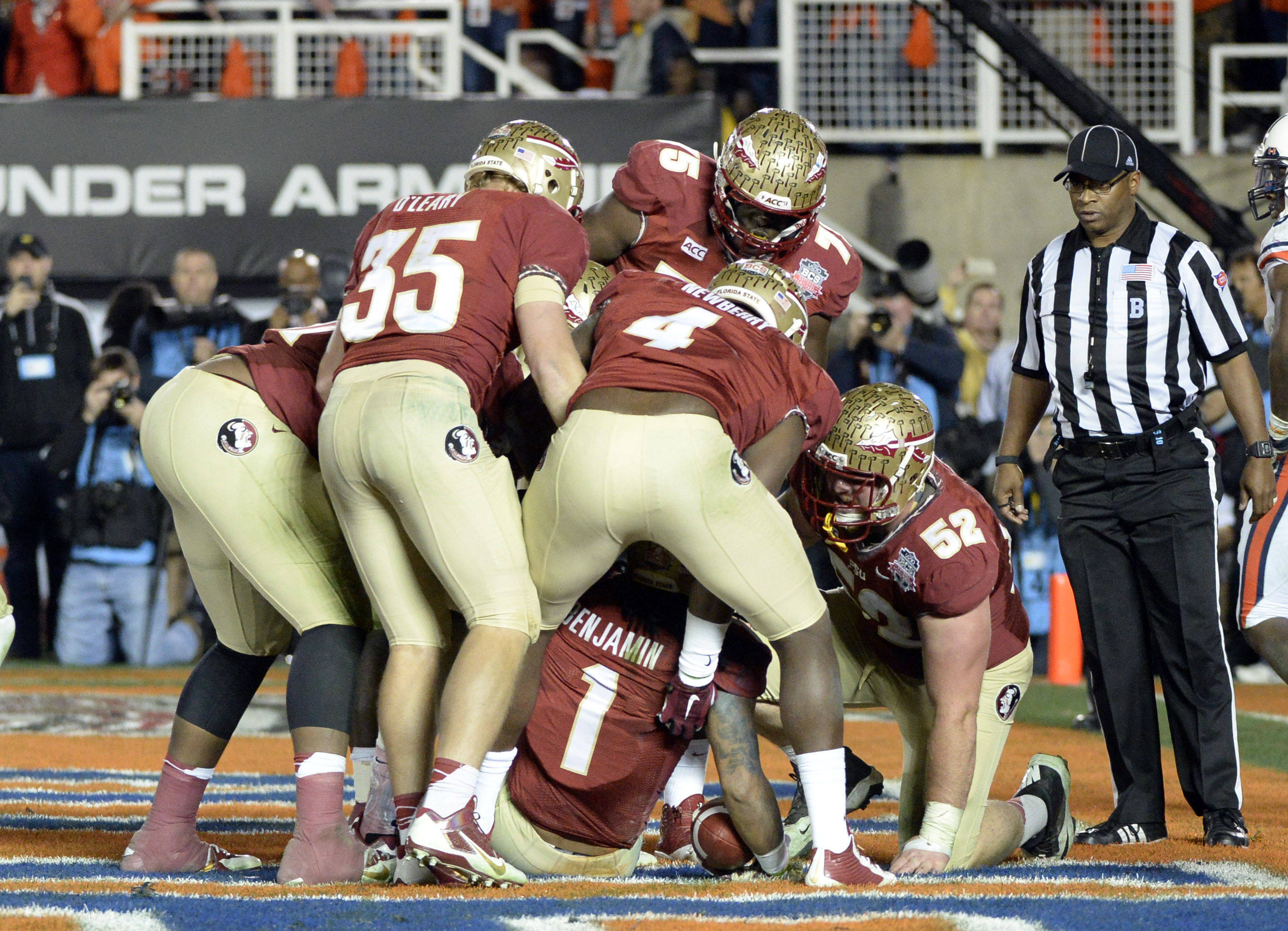 Jan 6, 2014; Pasadena, CA, USA; Florida State Seminoles tight end Nick O'Leary (35) and tight end Giorgio Newberry (4) and offensive linesman Bryan Stork (52) celebrate after wide receiver Kelvin Benjamin (1) caught a pass for a touchdown against the Auburn Tigers and during the second half of the 2014 BCS National Championship game at the Rose Bowl.  Mandatory Credit: Richard Mackson-USA TODAY Sports