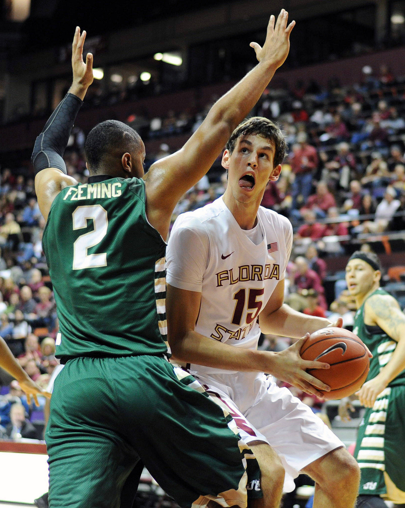 Nov 8, 2013; Tallahassee, FL, USA; Florida State Seminoles center Boris Bojanovsky (15) looks to shoot past Jacksonville Dolphins forward Kordario Fleming (2) during the first half at the Donald L. Tucker Center. Mandatory Credit: Melina Vastola-USA TODAY Sports
