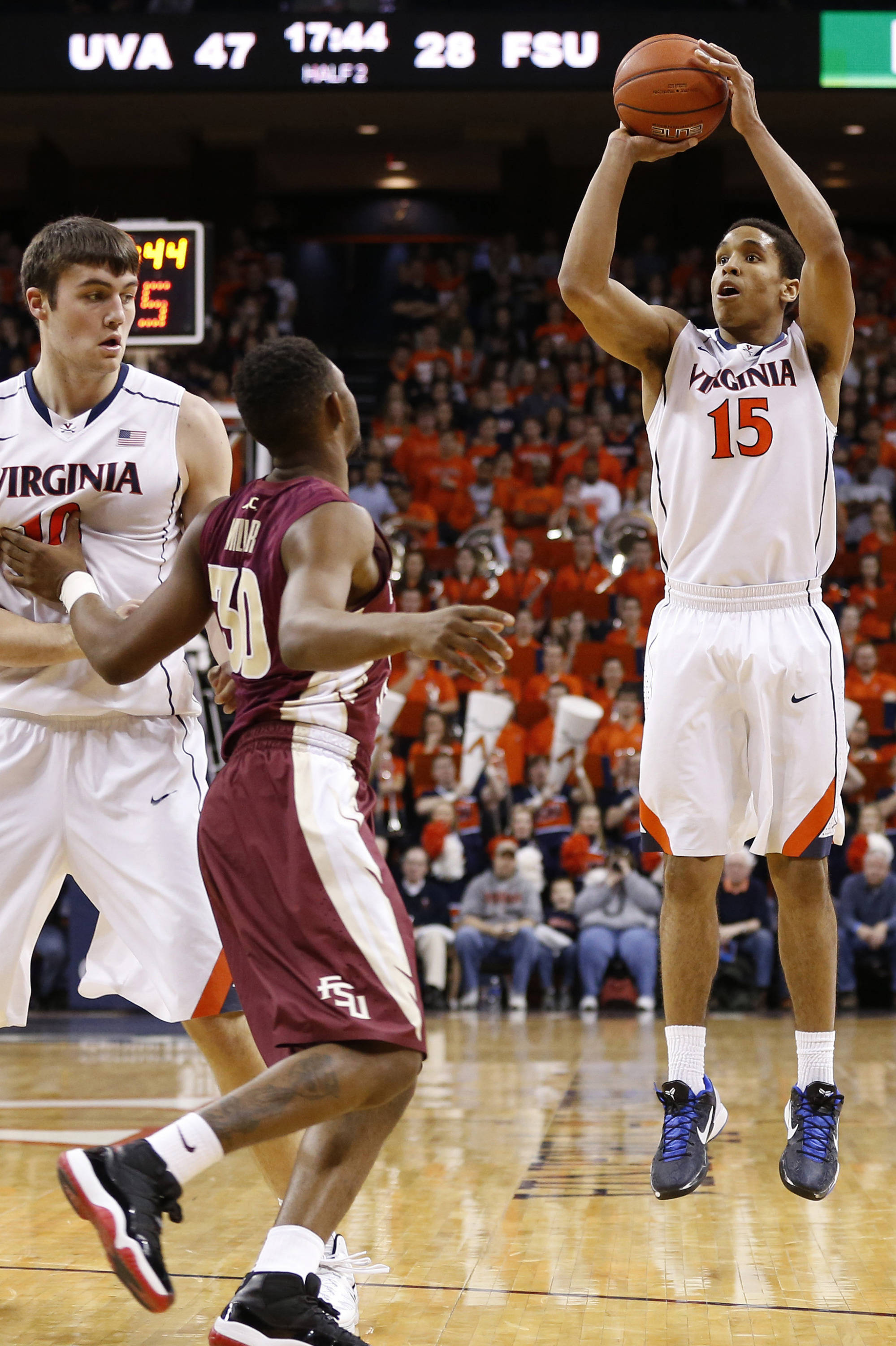 Jan 18, 2014; Charlottesville, VA, USA; Virginia Cavaliers guard Malcolm Brogdon (15) shoots the ball over Florida State Seminoles guard Ian Miller (30) in the second half at John Paul Jones Arena. The Cavaliers won 78-66. Mandatory Credit: Geoff Burke-USA TODAY Sports
