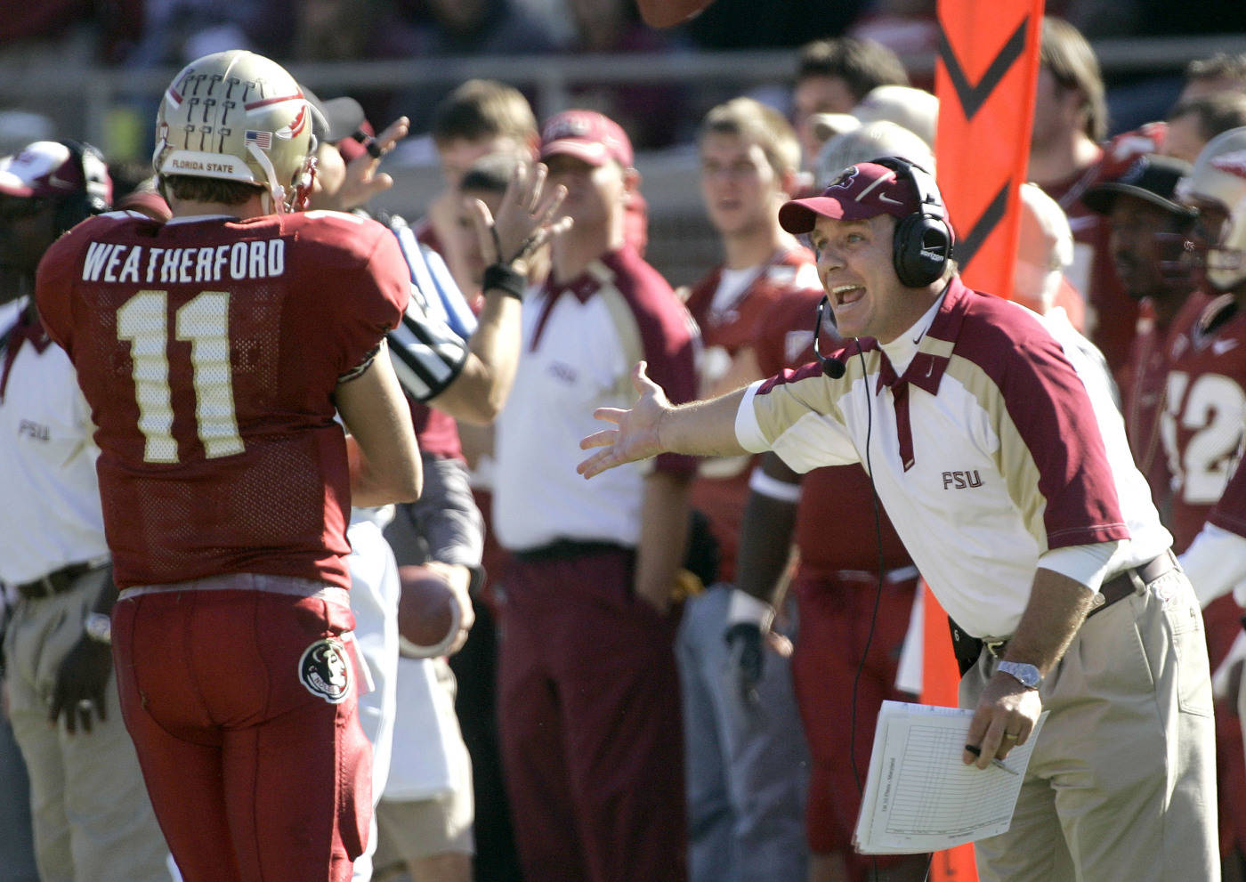 Florida State offensive coordinator Jimbo Fisher, right, has a discussion with quarterback Drew Weatherford during the fourth quarter.