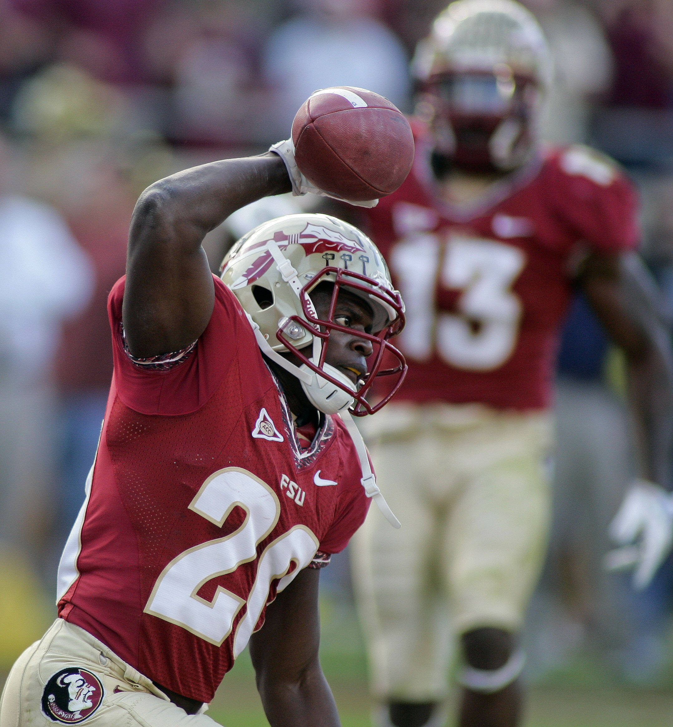 Florida State safety Lamarcus Joyner (20) spikes the ball after making an interception in the end zone during the first quarter of an NCAA college football game against Miami on Saturday, Nov. 12, 2011, in Tallahassee, Fla. Joyner was penalized on the play. (AP Photo/Phil Sears)